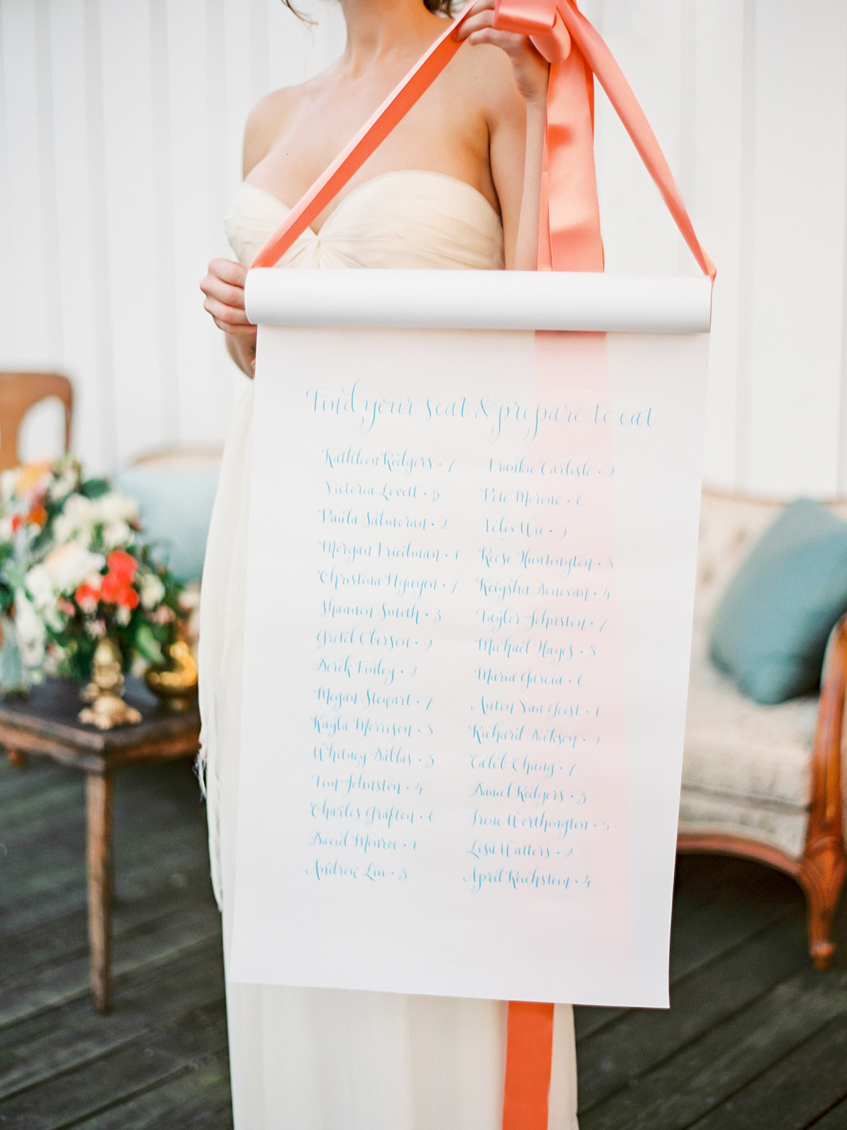 vellum seating chart scroll held by bride