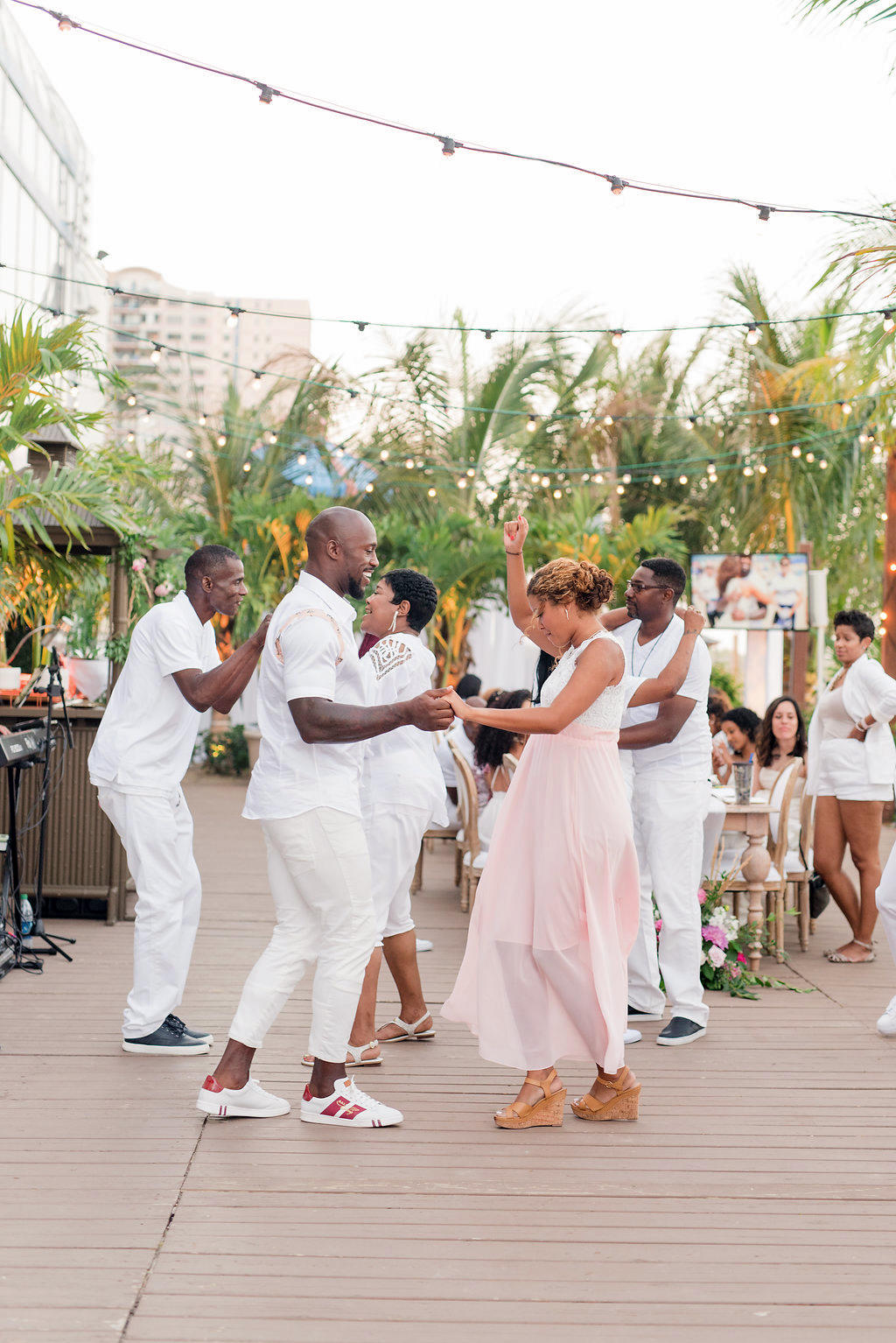 couples dancing outdoors on dock