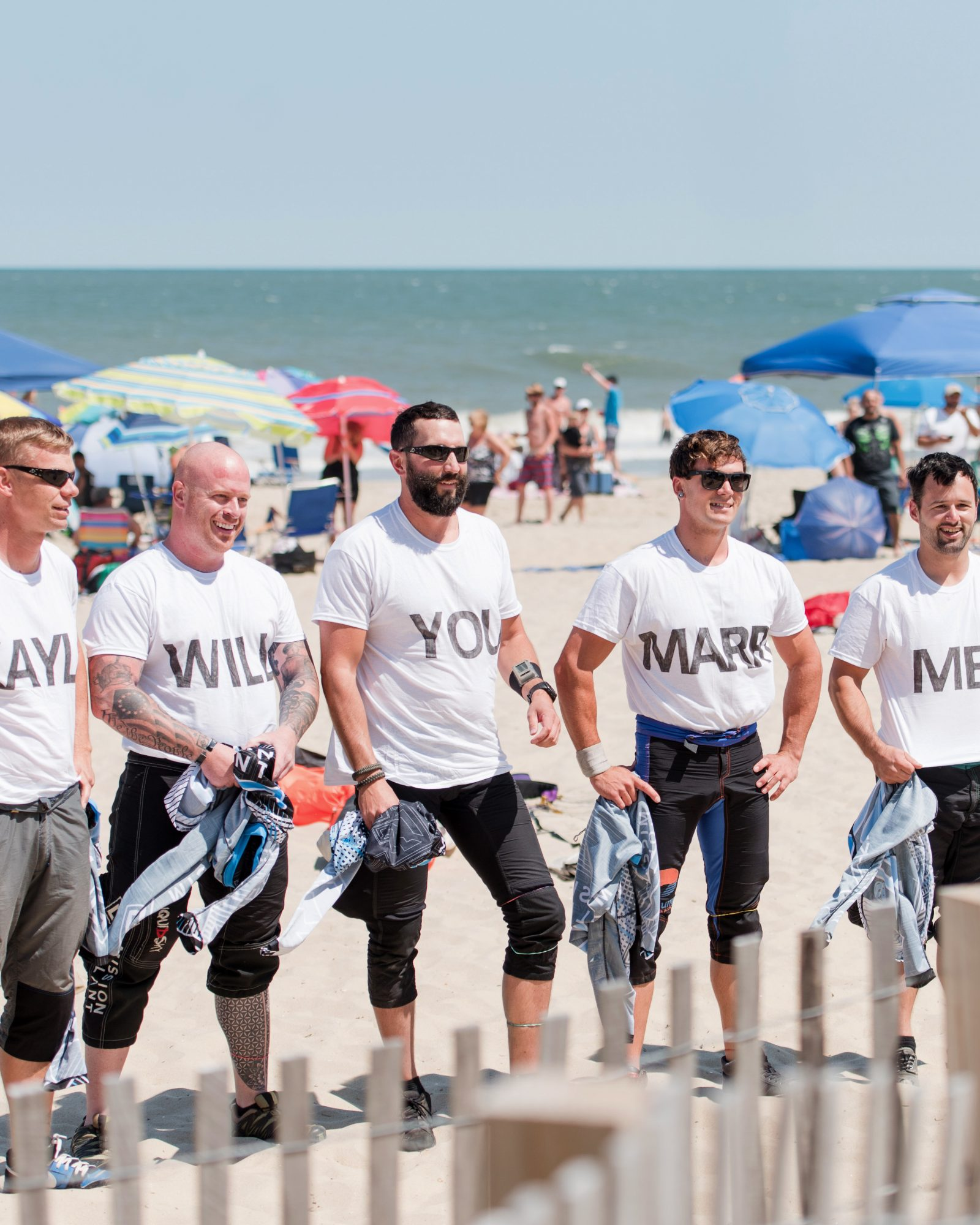 skydivers with proposal words on shirts