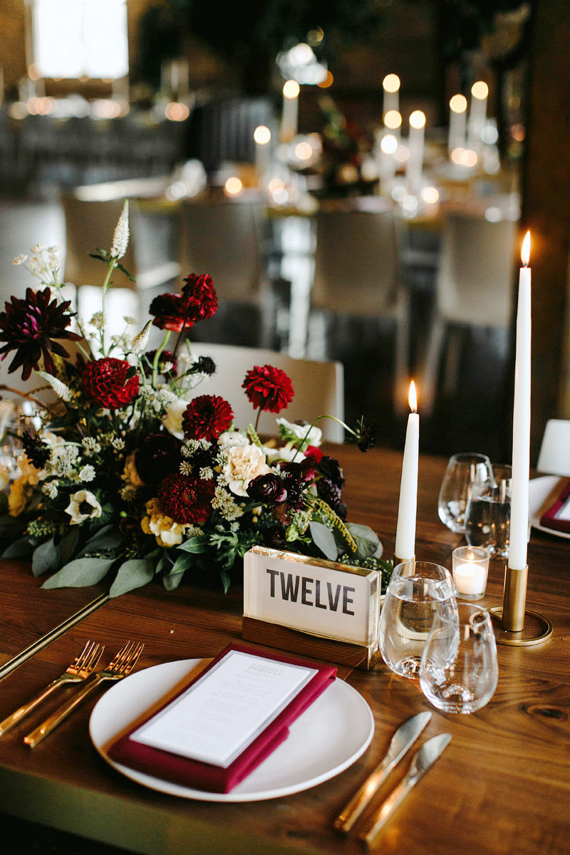 fall wedding centerpieces candle dark red burgundy place setting