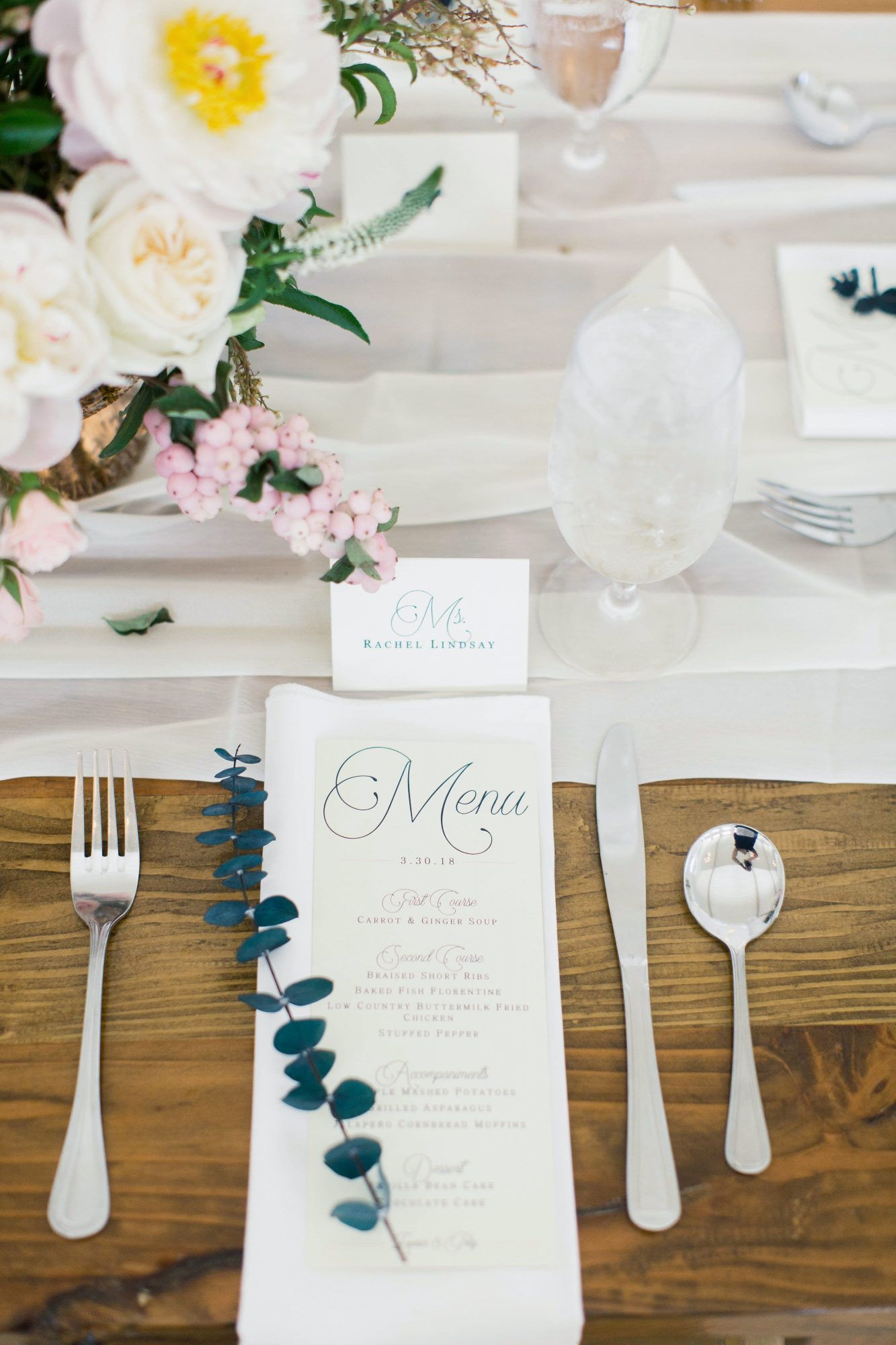 wedding table setting with name tags menu and leaves