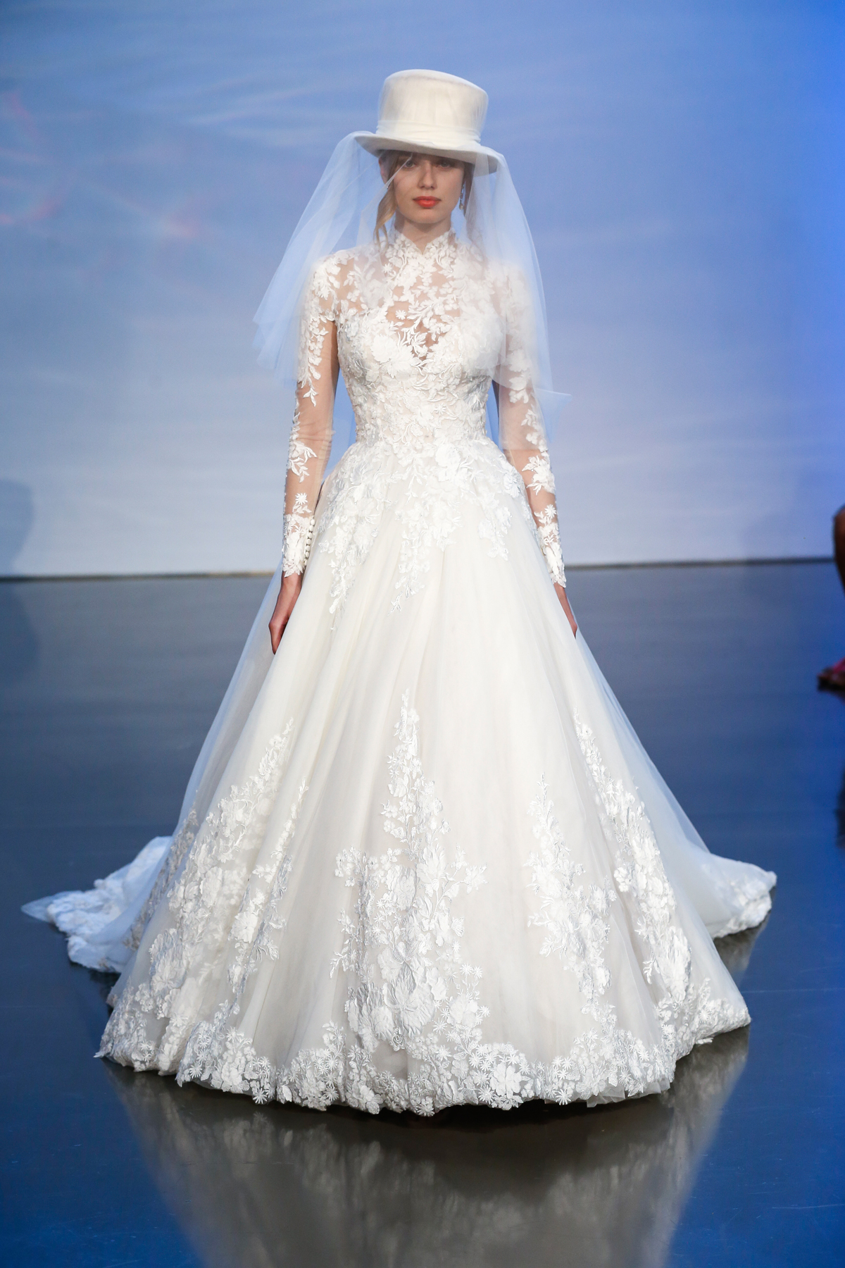 justin alexander signature fall 2019 lace long sleeve turtleneck ballgown with top hat veil