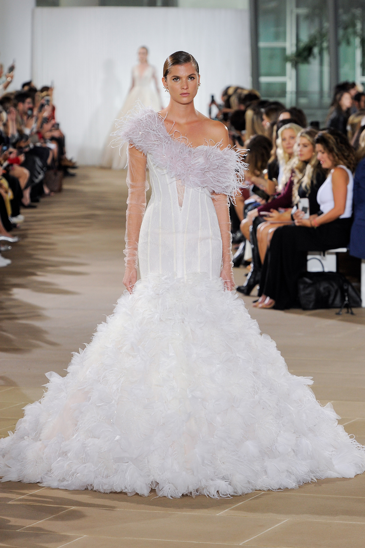 ines di santo fall 2019 one-shoulder trumpet with sheer long sleeves and feathers