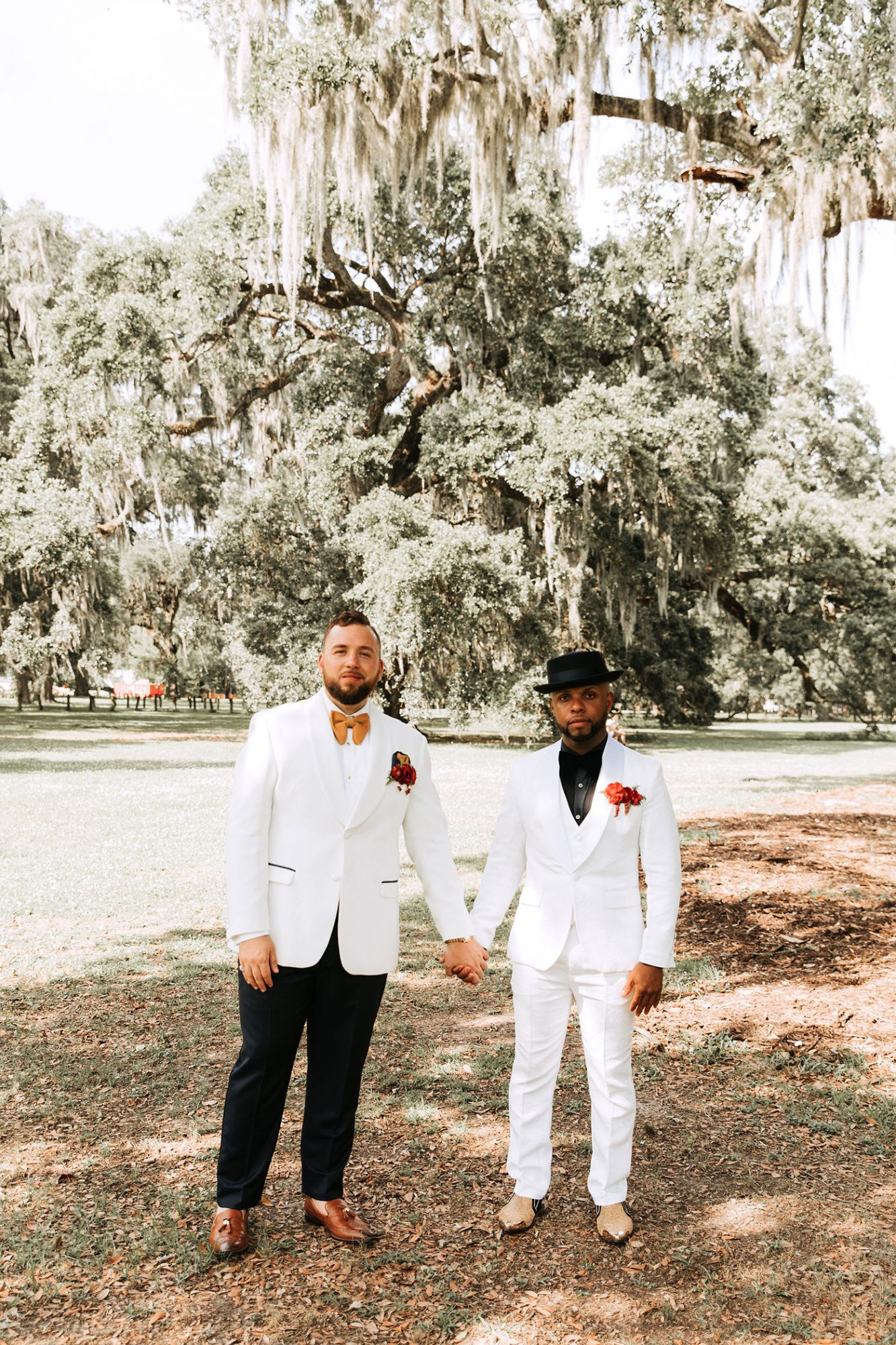 joe tim new orleans wedding grooms holding hands