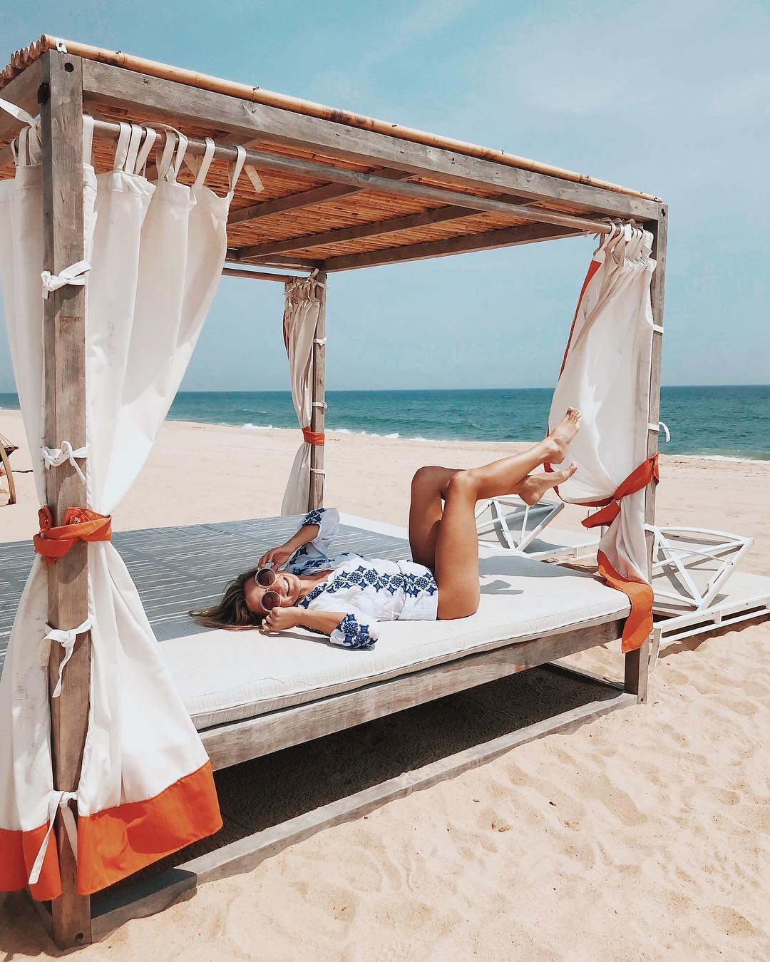bachelorette cities gurneys montaul women lying on day bed on the beach