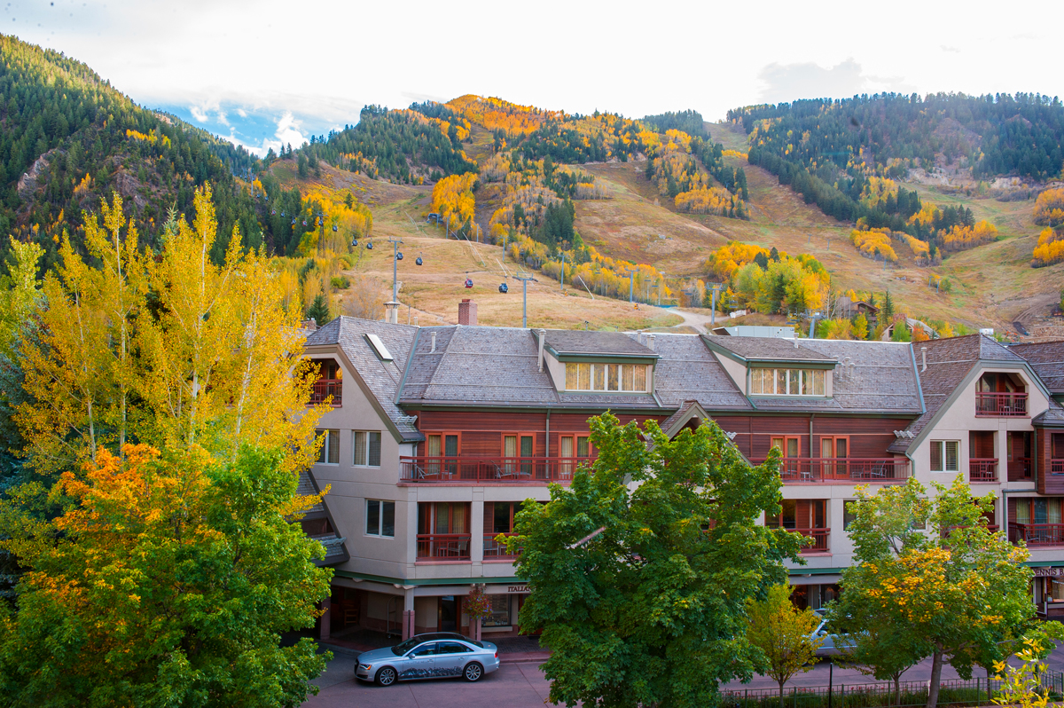 aspen lodge surrounded by fall foliage