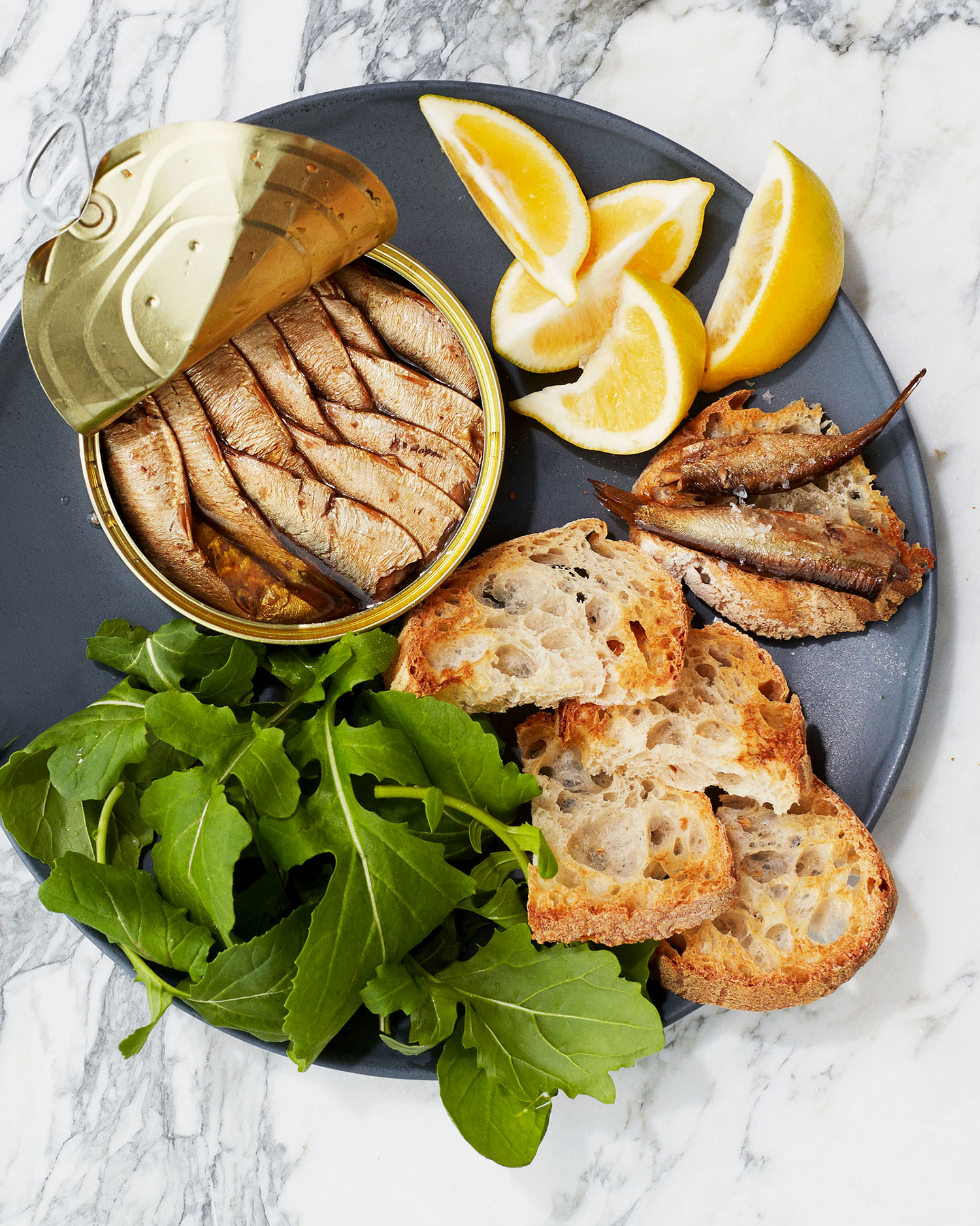 tinned fish on toast with greens and lemon