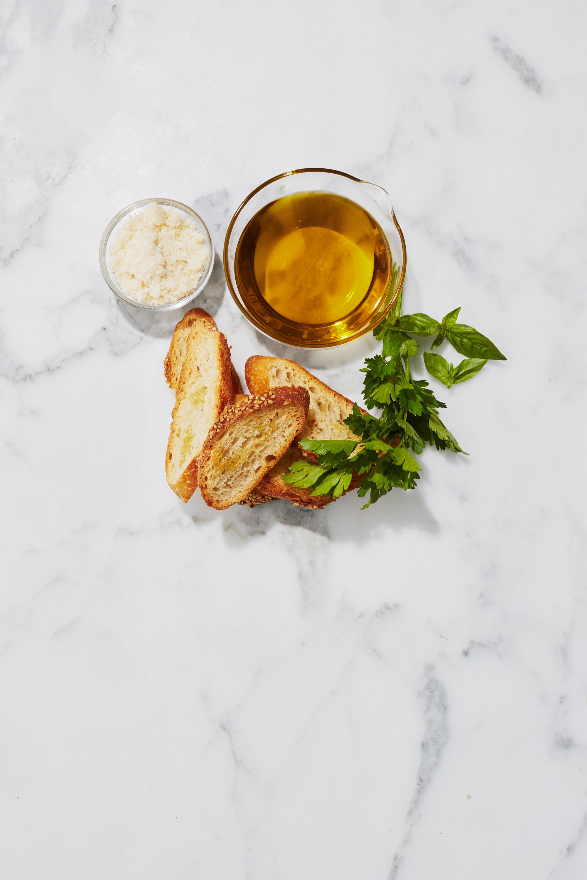 olive oil shredded parmesan fresh herbs and toasted bread for soup