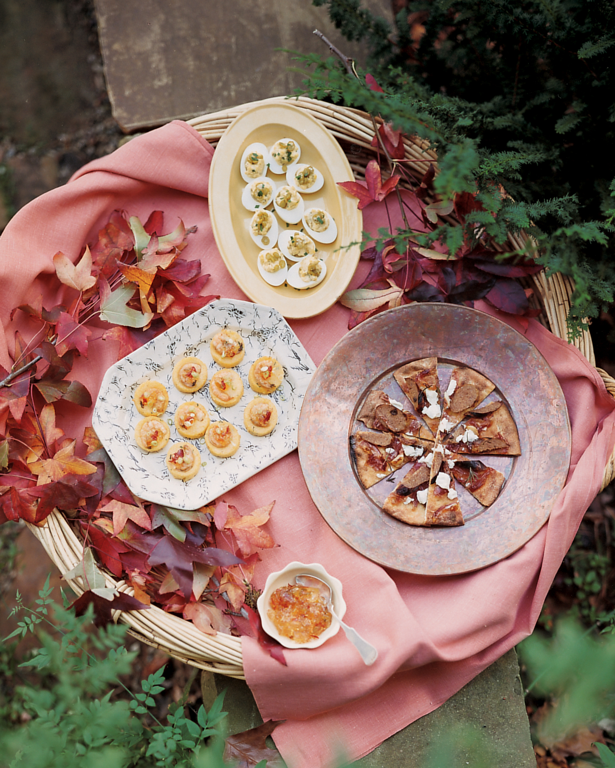 outdoor assorted appetizers with fall leaves decor