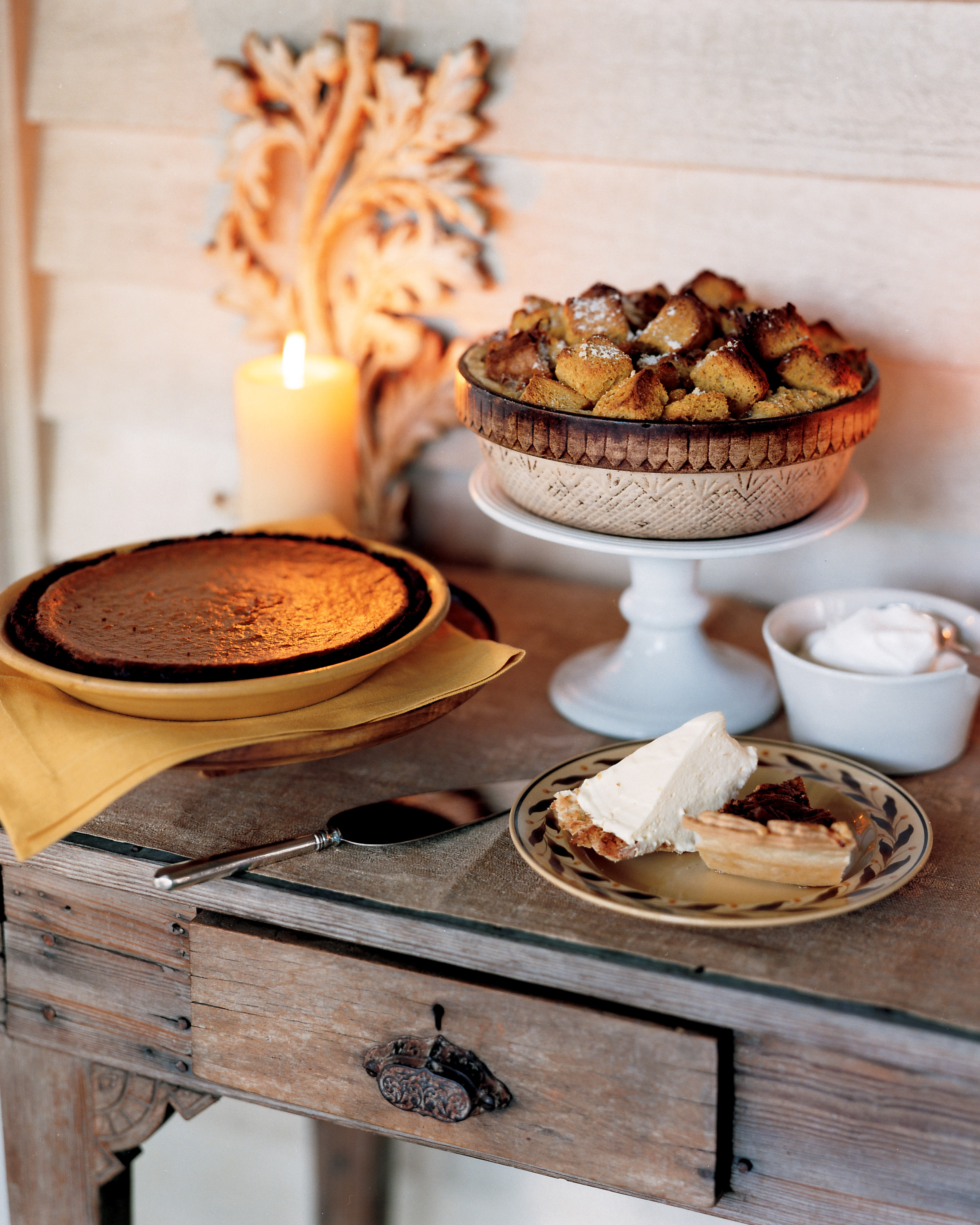 dessert table with pies and bread pudding