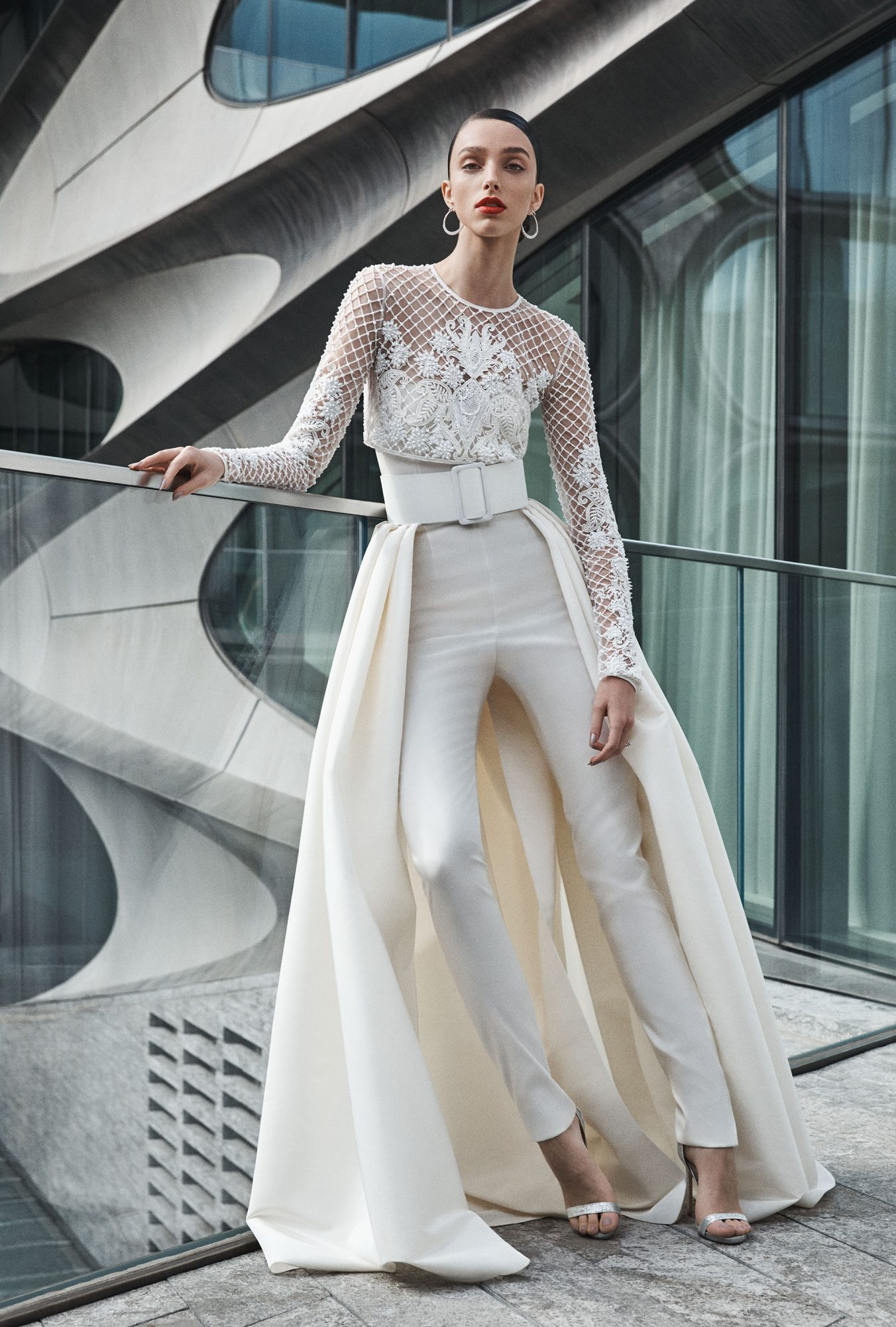 naeem khan wedding dress jumpsuit with long sleeves and skirt overlay with wide belt