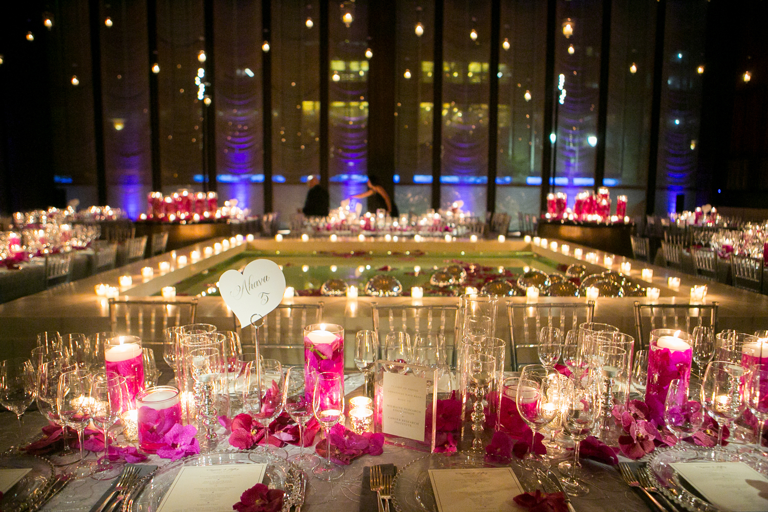 after party decor candles and pink flowers around dining hall