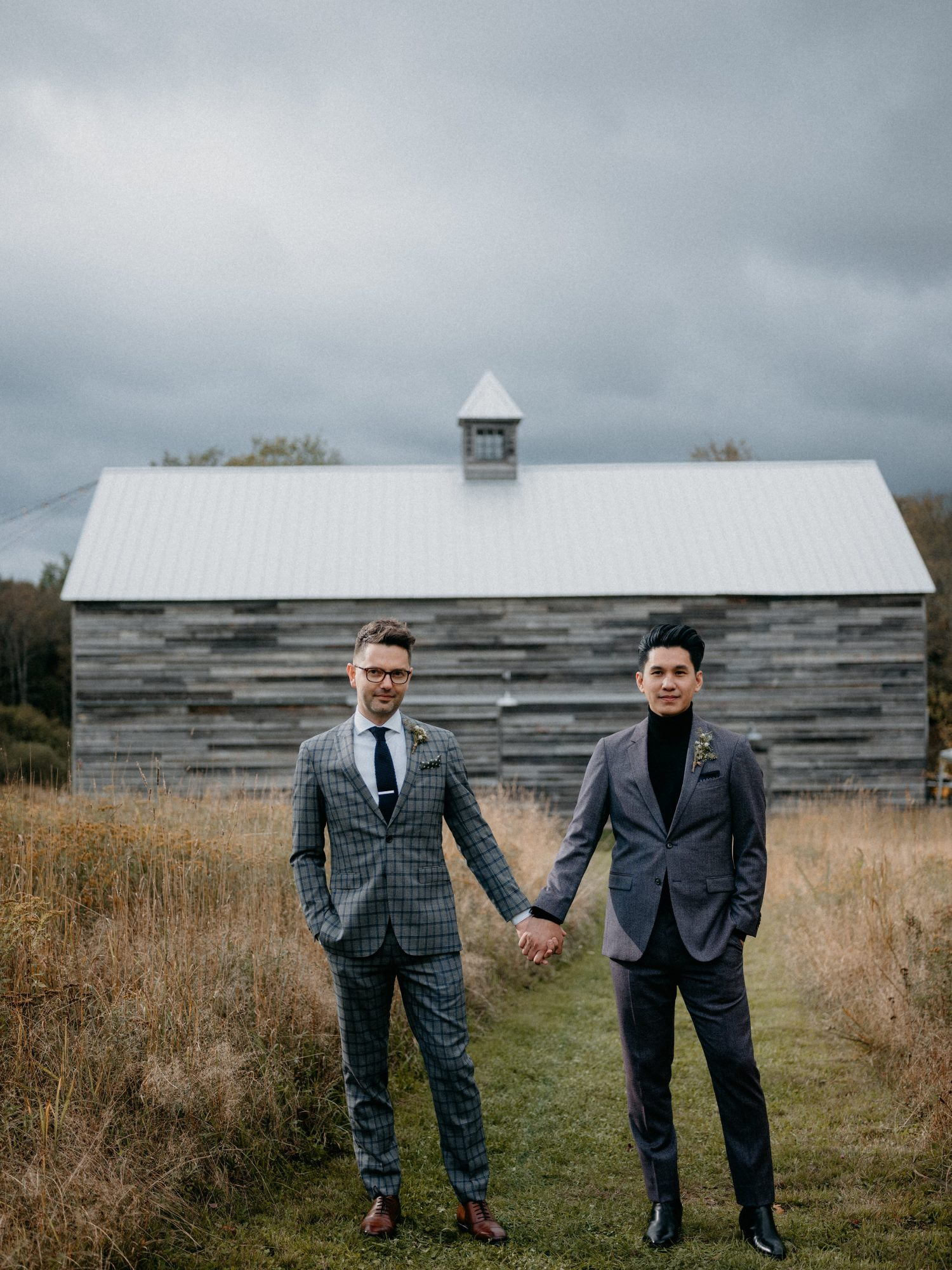 eric eryc wedding grooms in front of barn