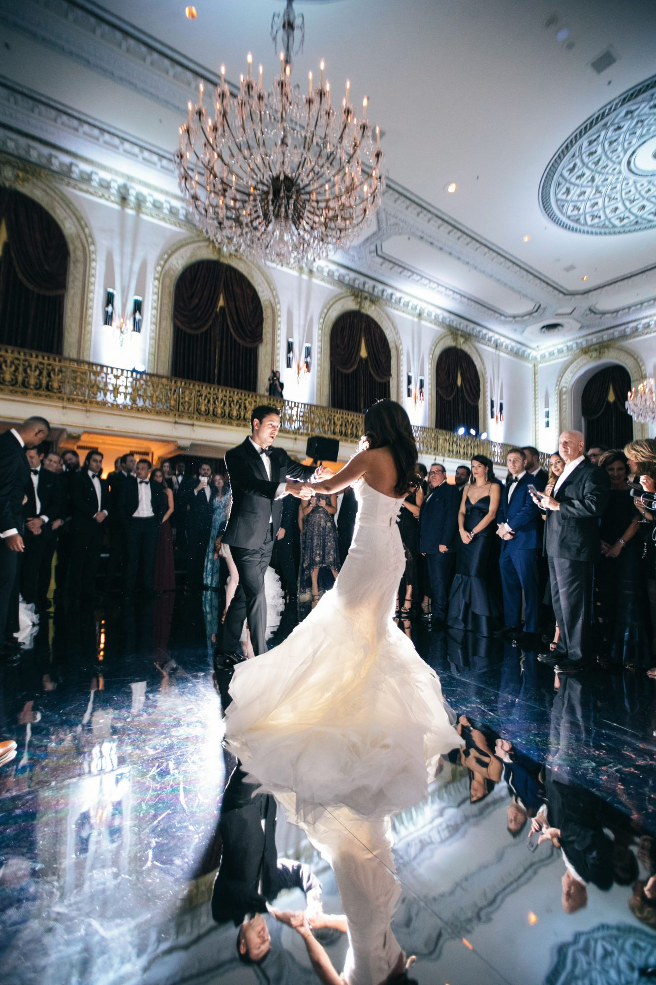 wedding couple dancing on mirrored ballroom floor