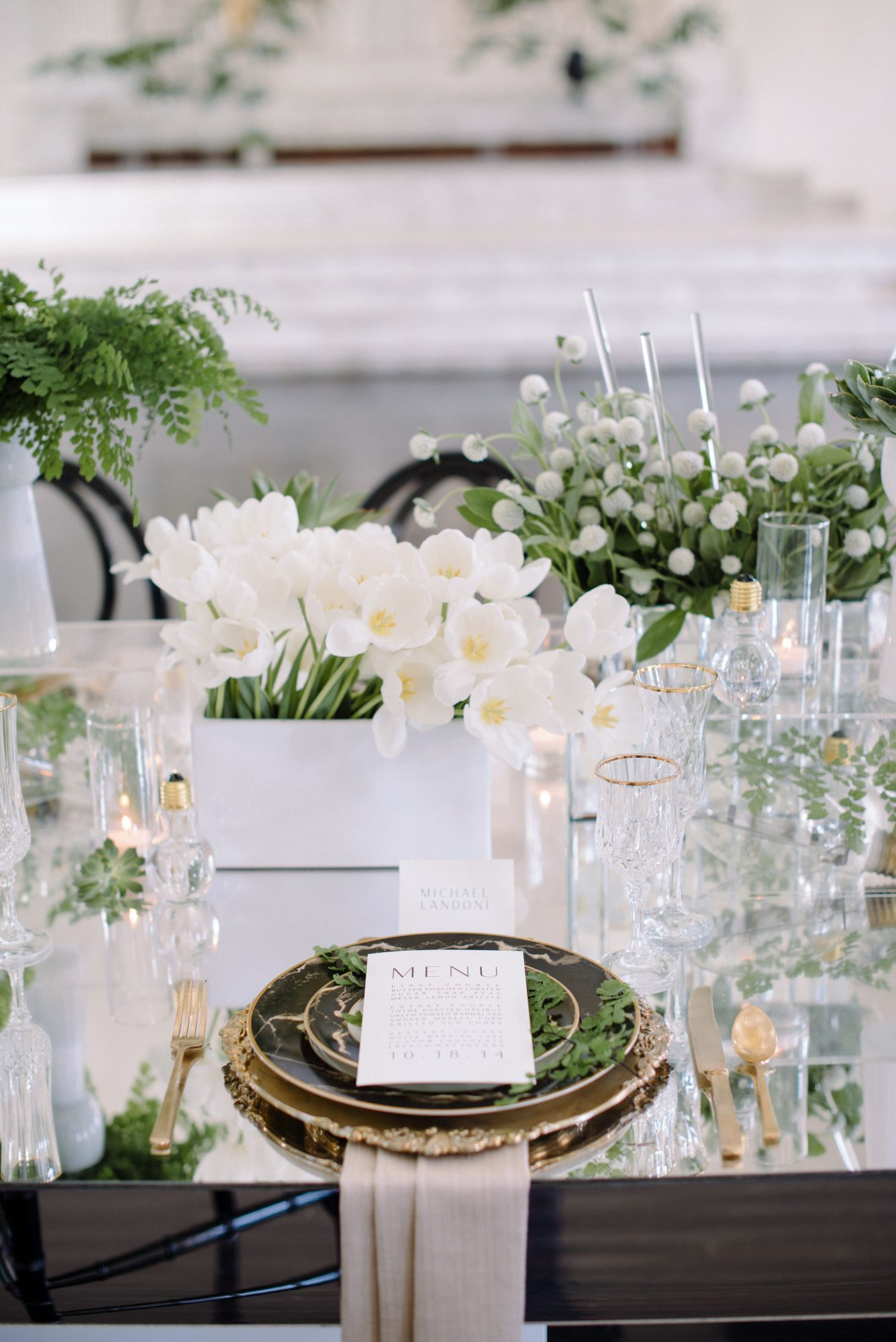 table setting and menu on mirror table topper