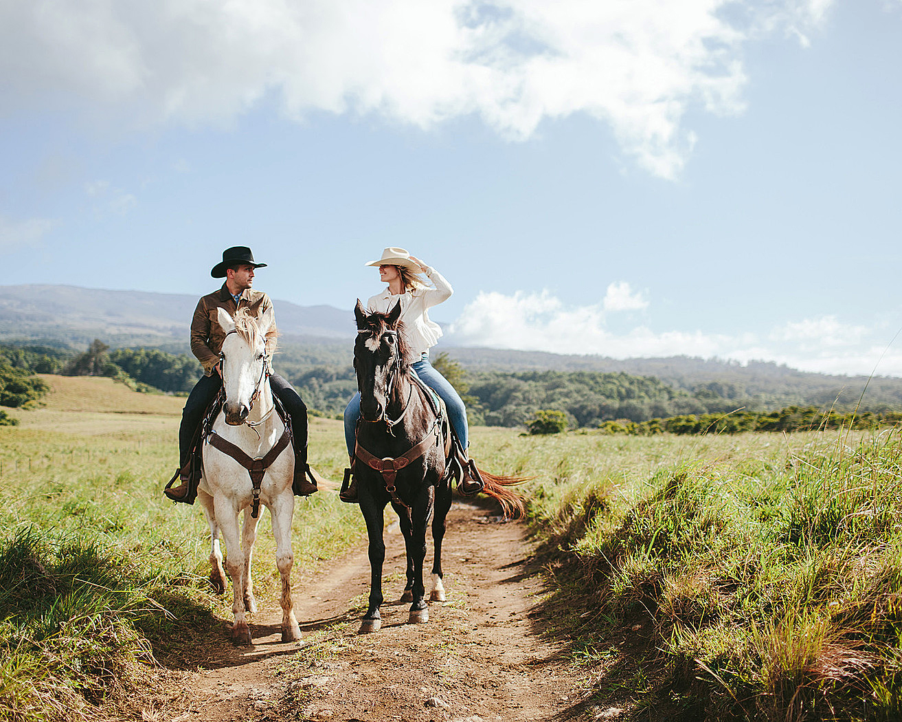 hawaii experiences man and woman horsebackriding