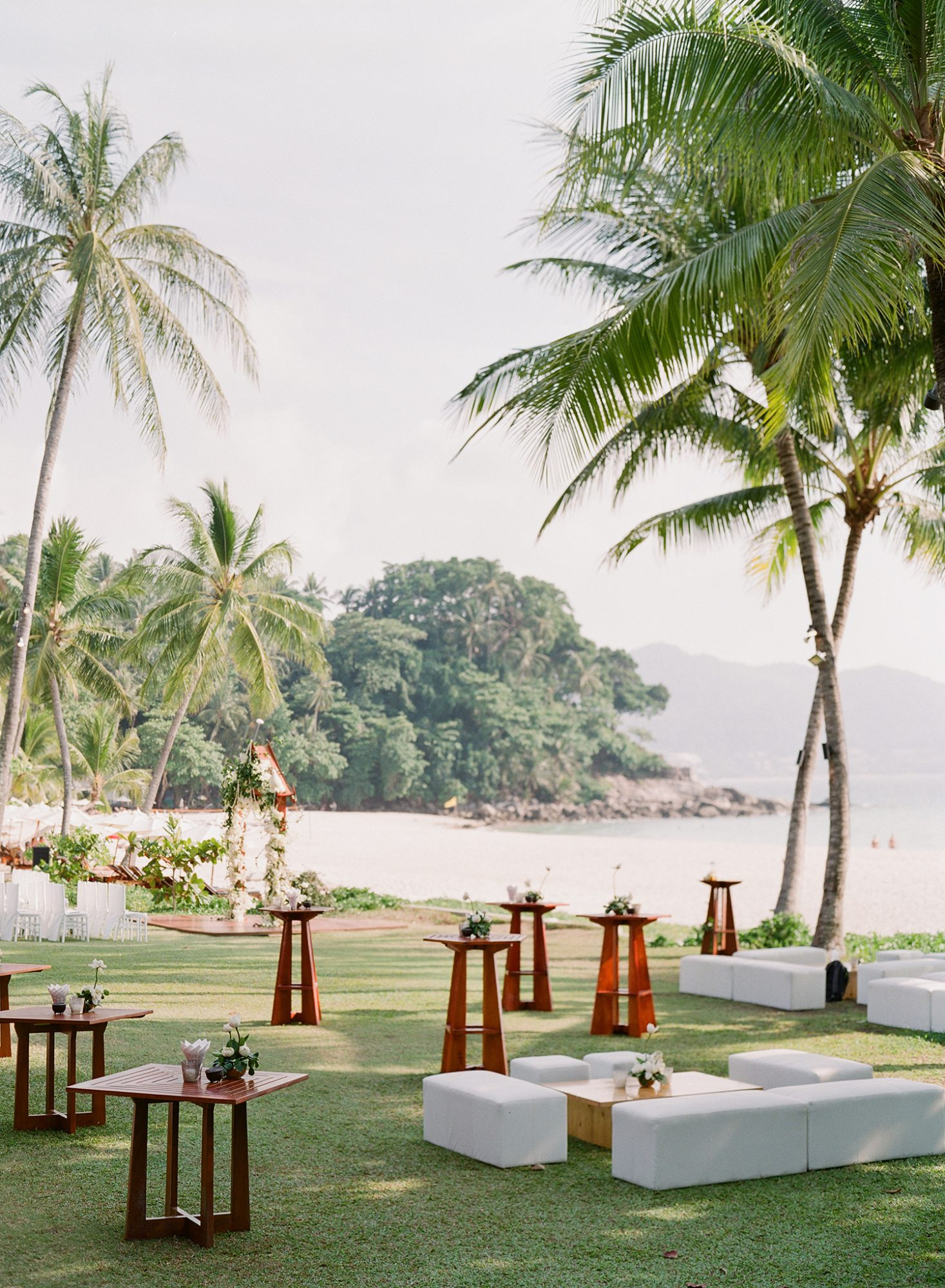 stacy brad wedding cocktail hour set up under palm trees