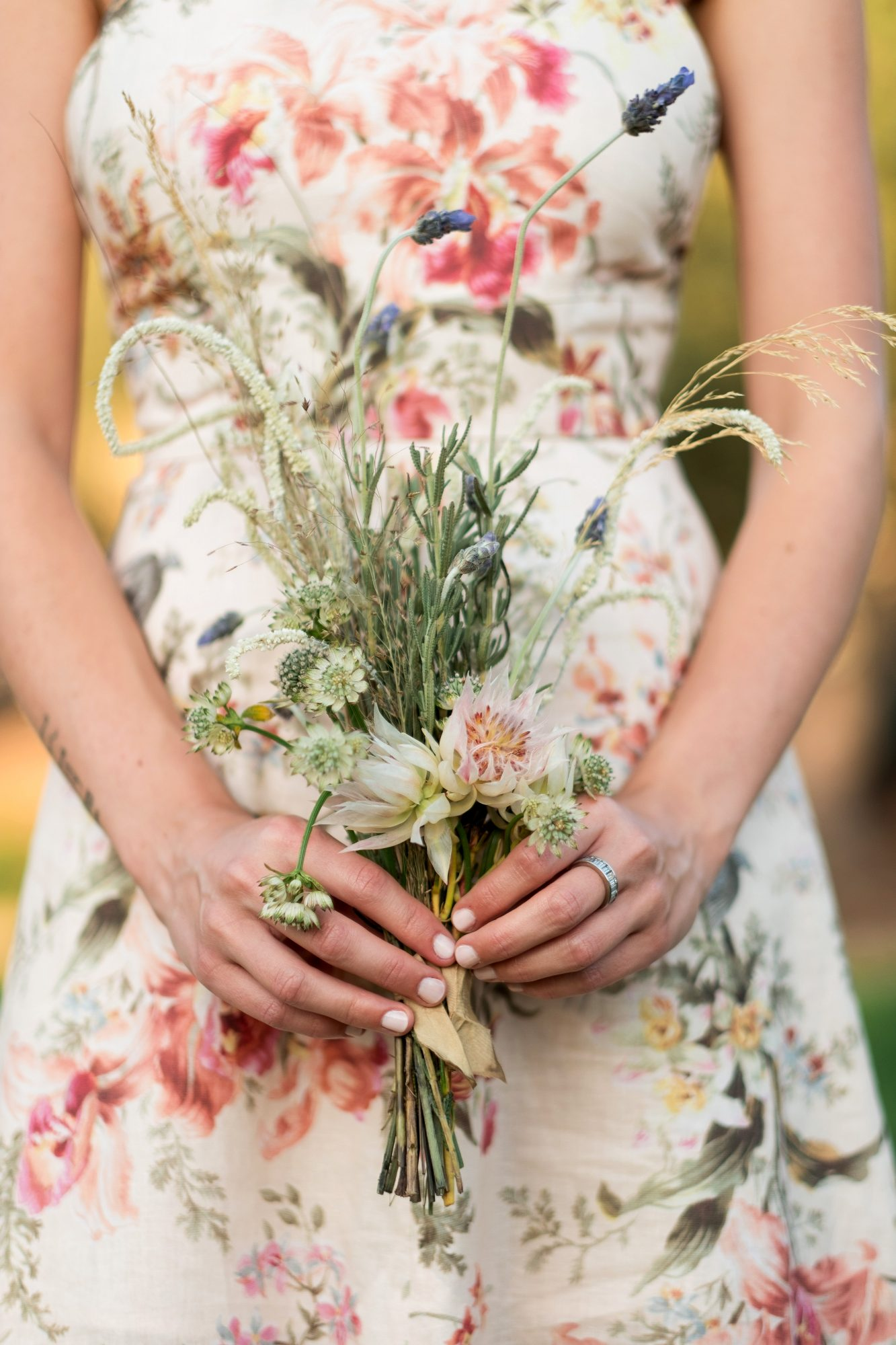 anika max wedding bridesmaid wearing floral dress holding bouquet