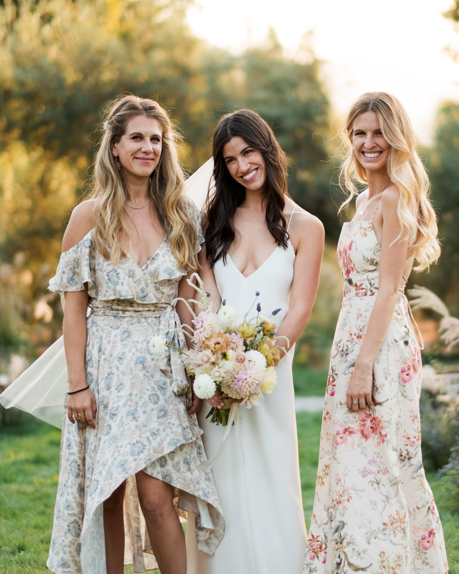 anika max wedding bridesmaids wearing floral mismatched dresses