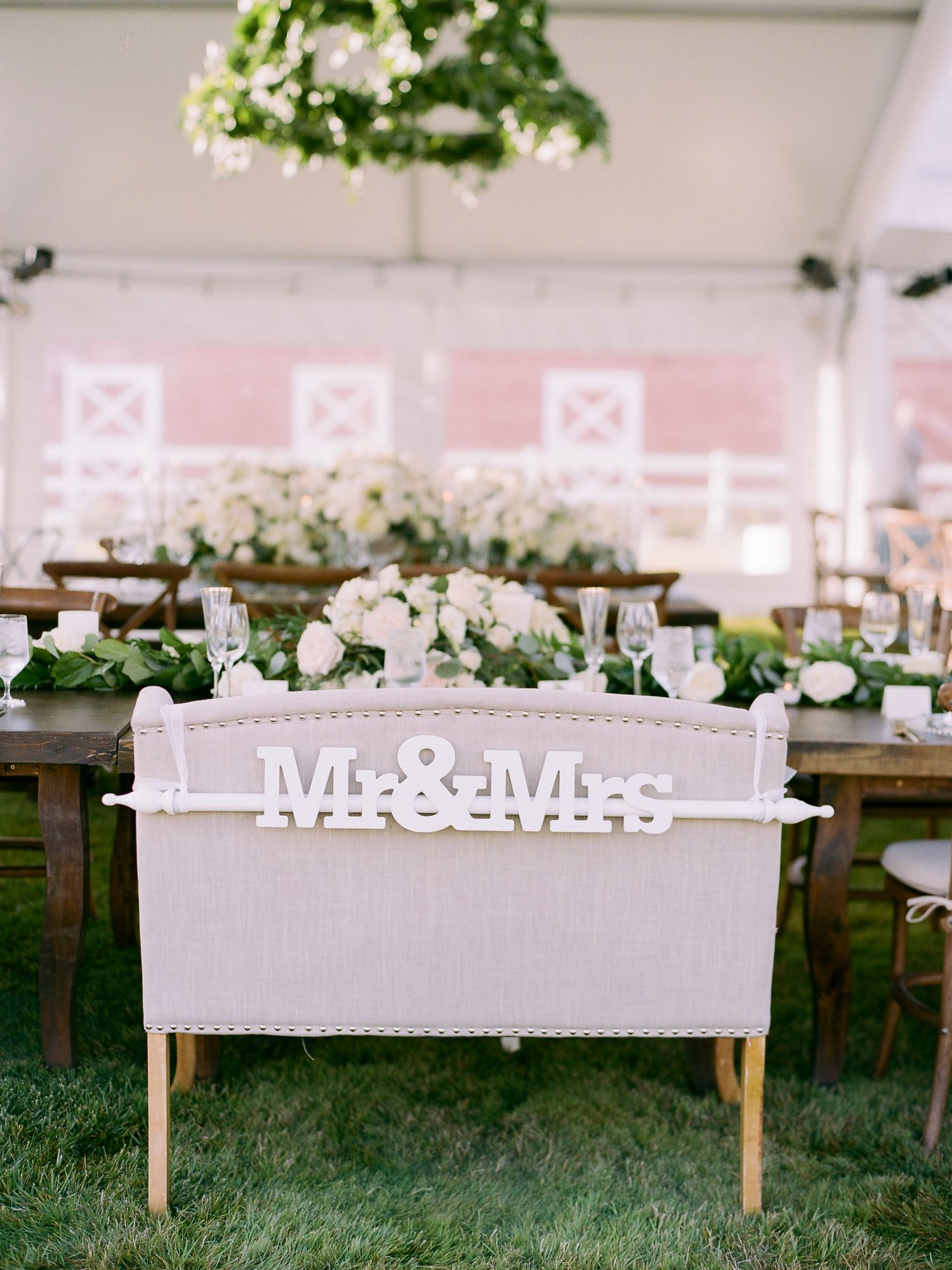mr and mrs signs connected titles spanning chair