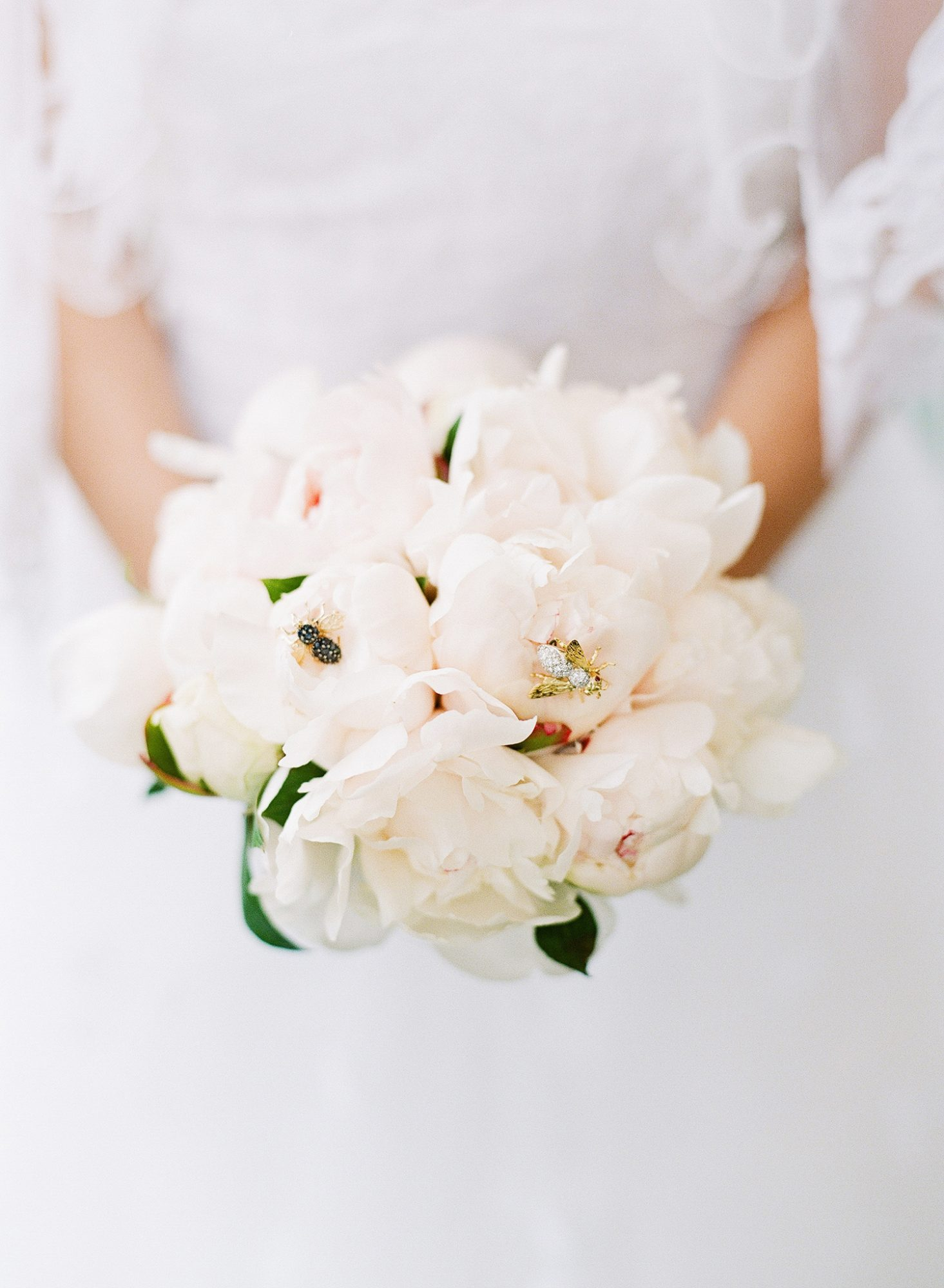 bee wedding ideas bride holding bouquet