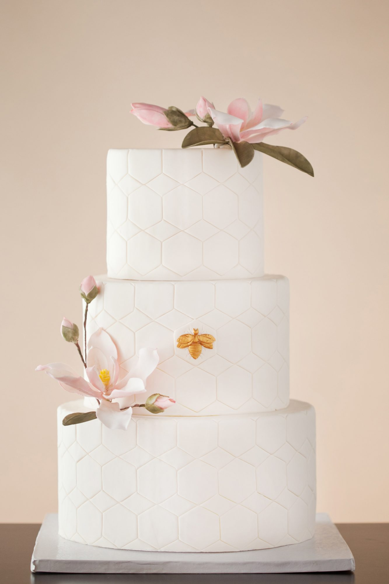 bee wedding ideas cake with flowers and hexagon pattern