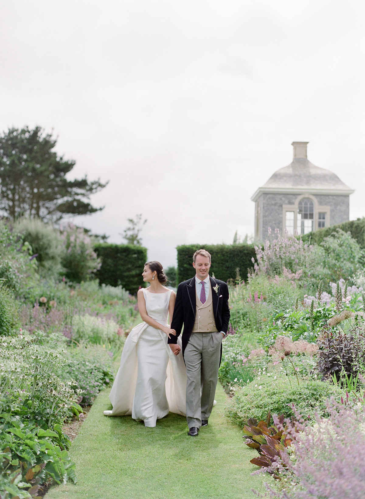 peony matthew england wedding couple walking through garden