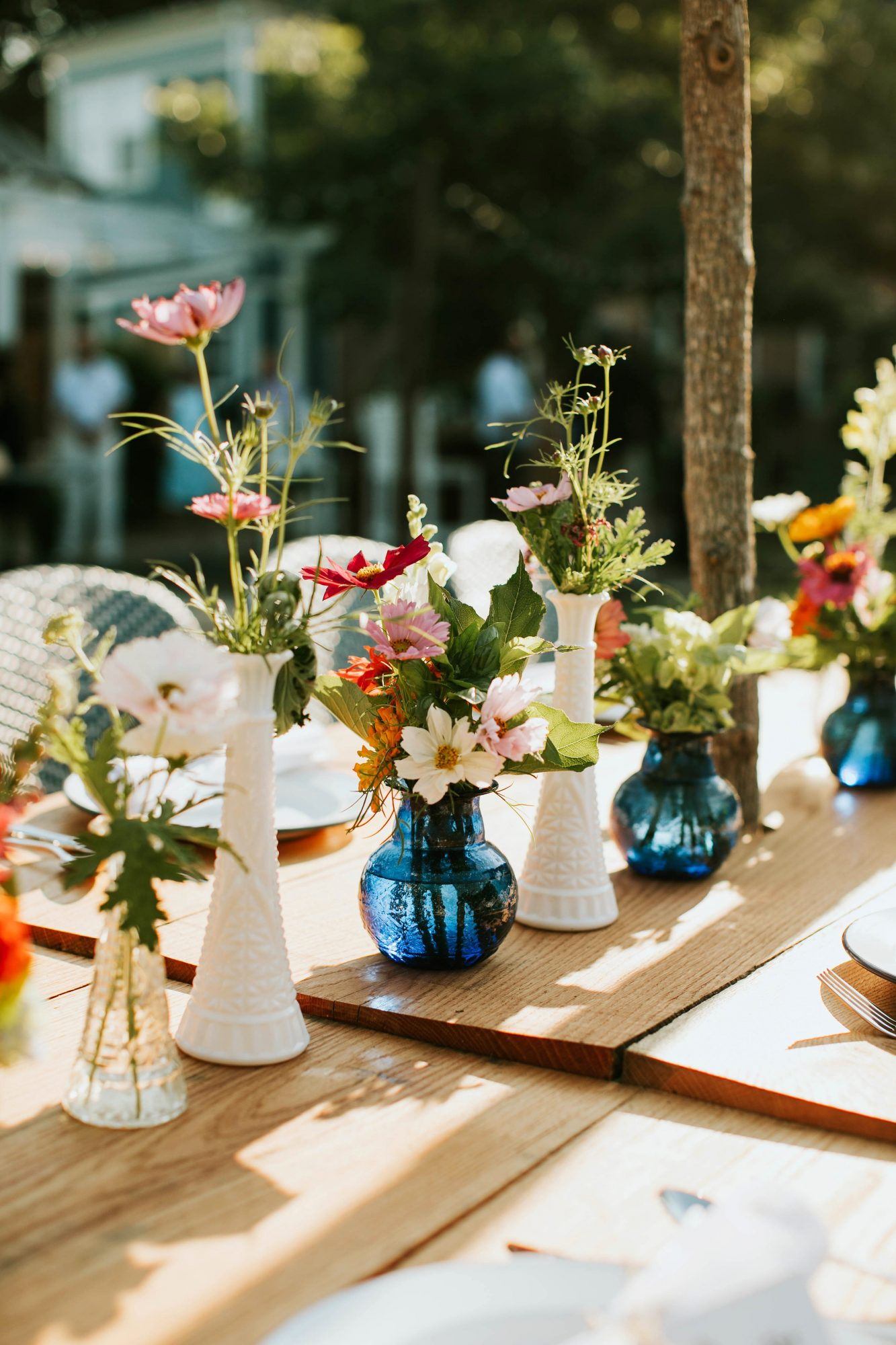leah michael wedding welcome dinner vases table centerpieces