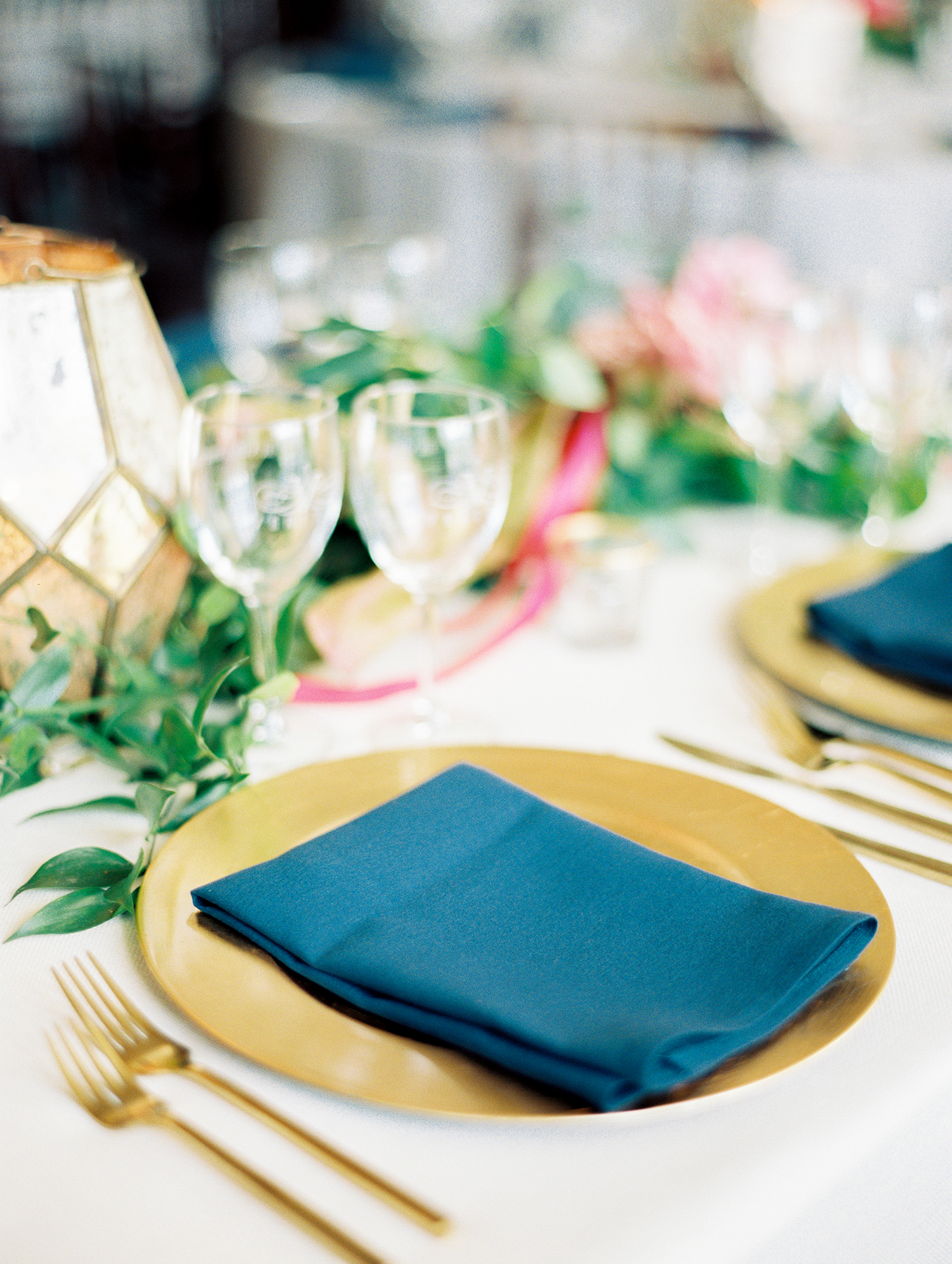 dawn rich wedding place setting blue napkin on gold charger