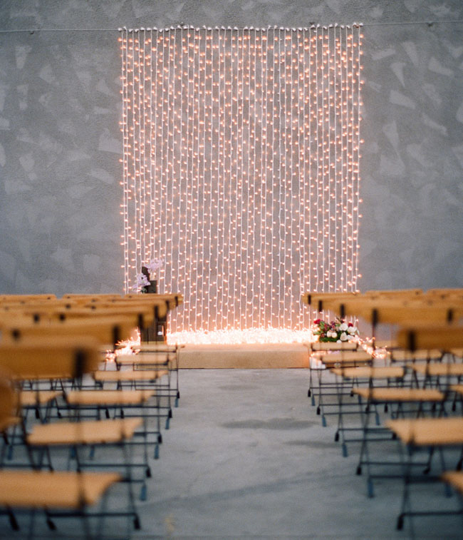 twinkle lights against gray ceremony wall