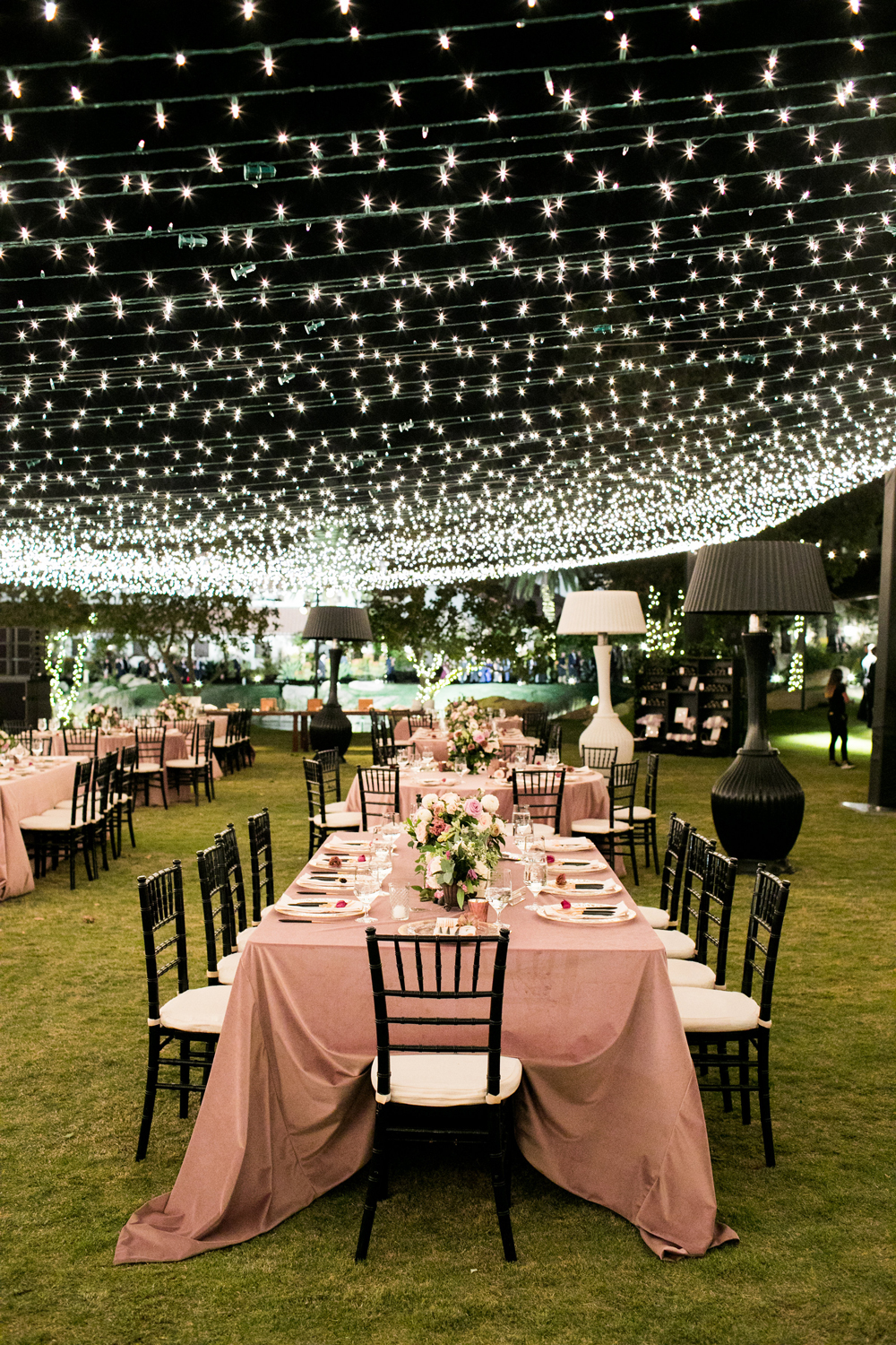twinkle lights creating roof above reception tables