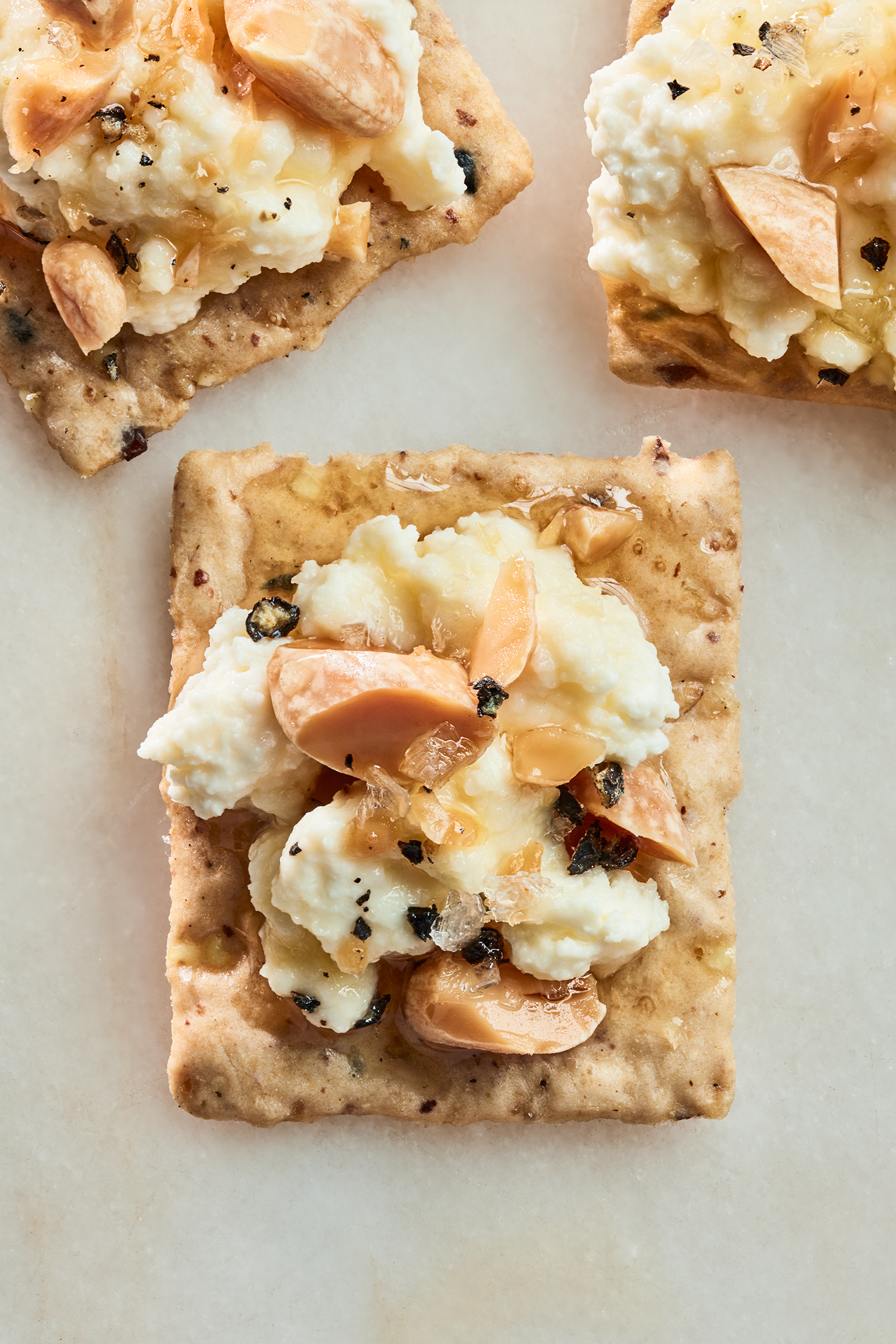 cracker with almonds and ricotta