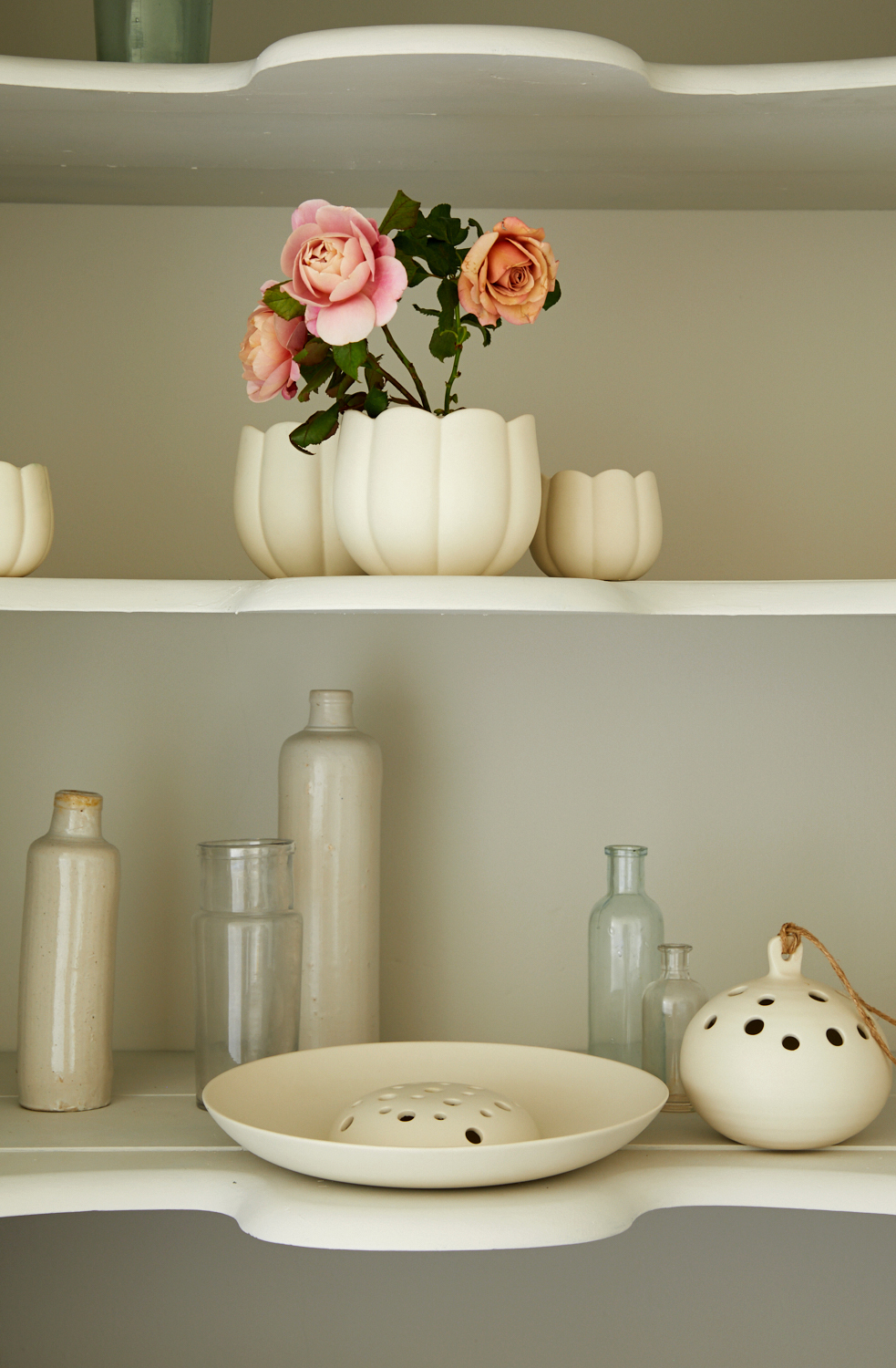 ceramic floral display on shelves