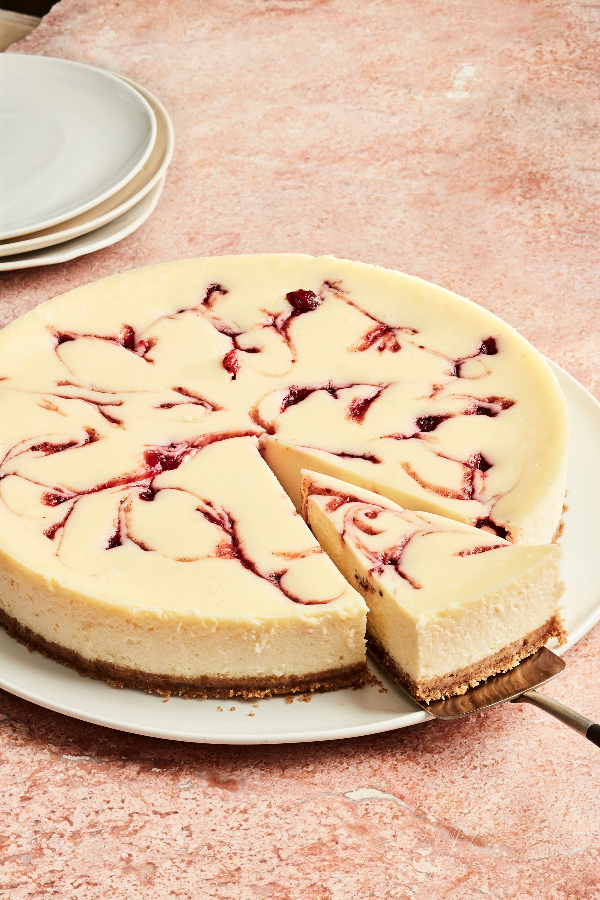 round cranberry cheesecake with slice cut