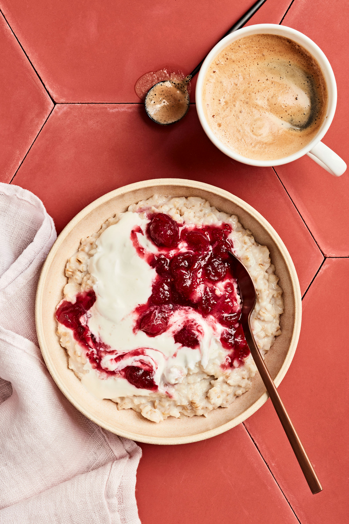 oatmeal and yogurt topped with cranberry sauce