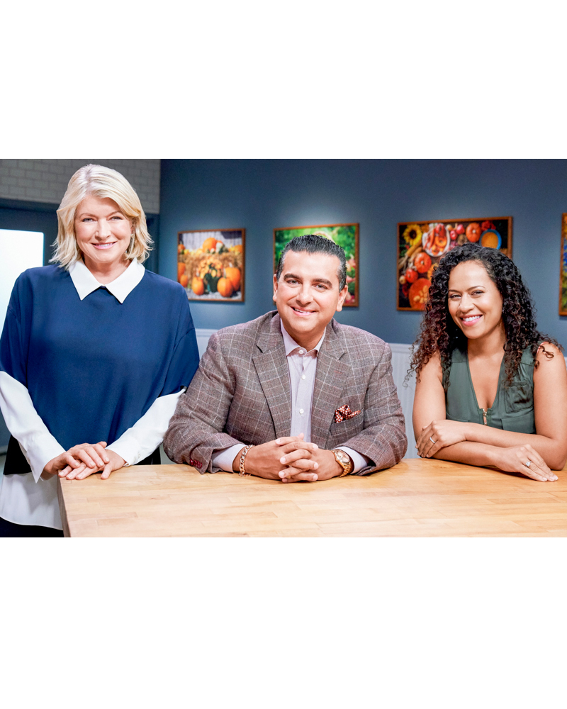 martha stewart with guests buddy valastro and yolanda gampp posed at counter