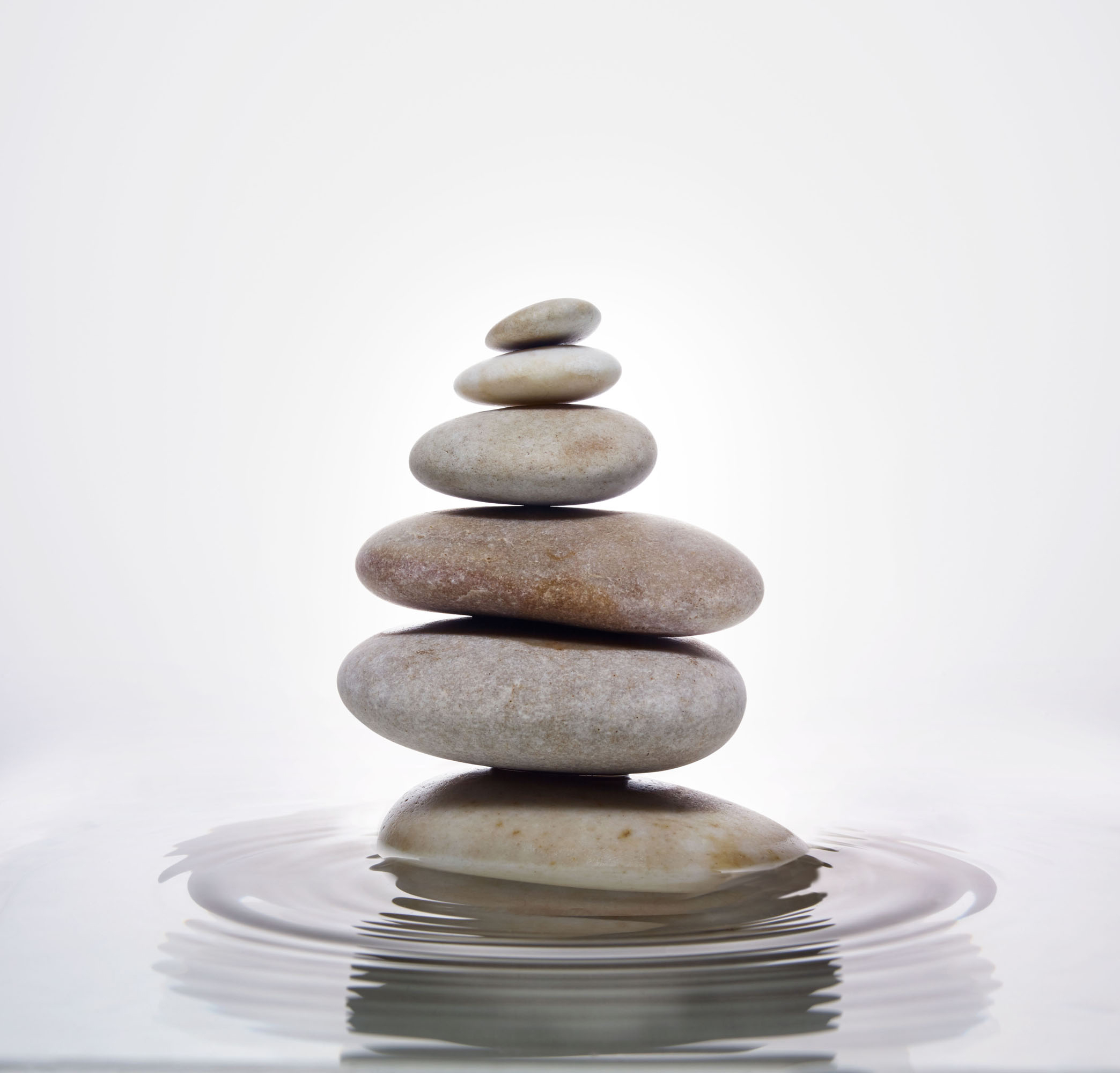 stack of stones in water with ripples