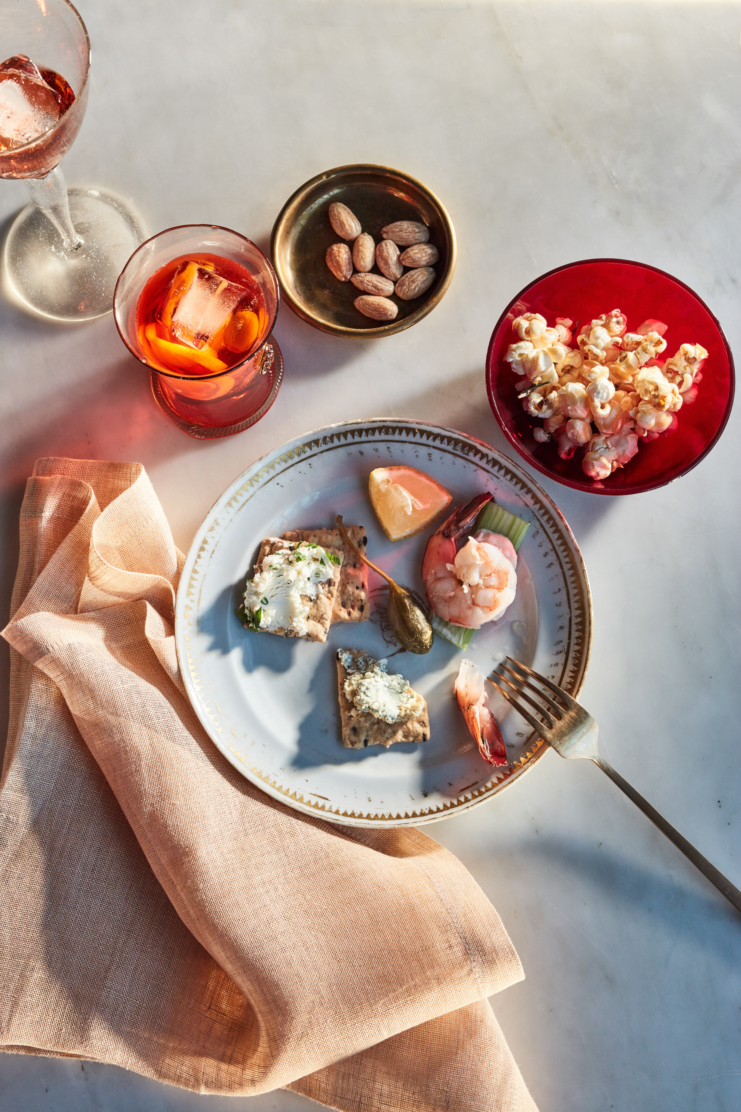 holiday appetizers on plate almonds popcorn crackers