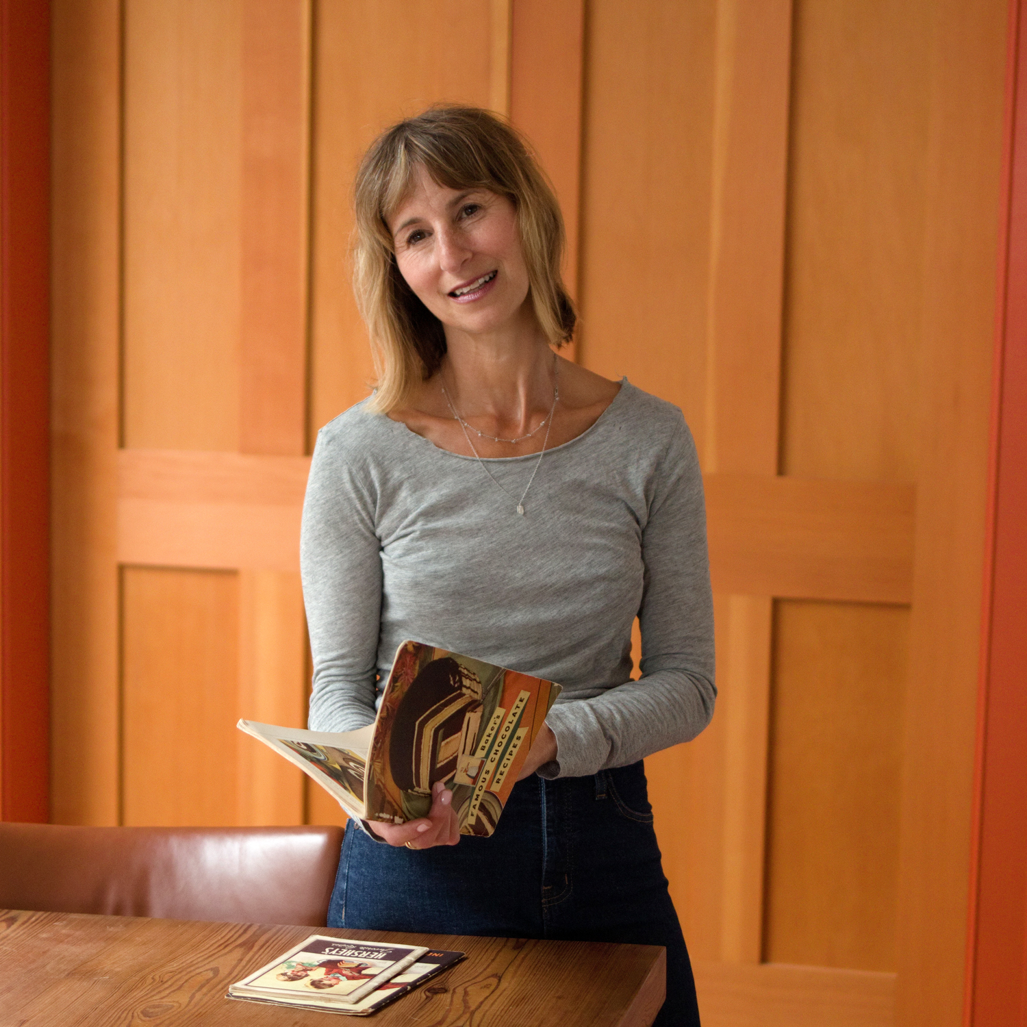 portrait of jessie sheehan with cookbook