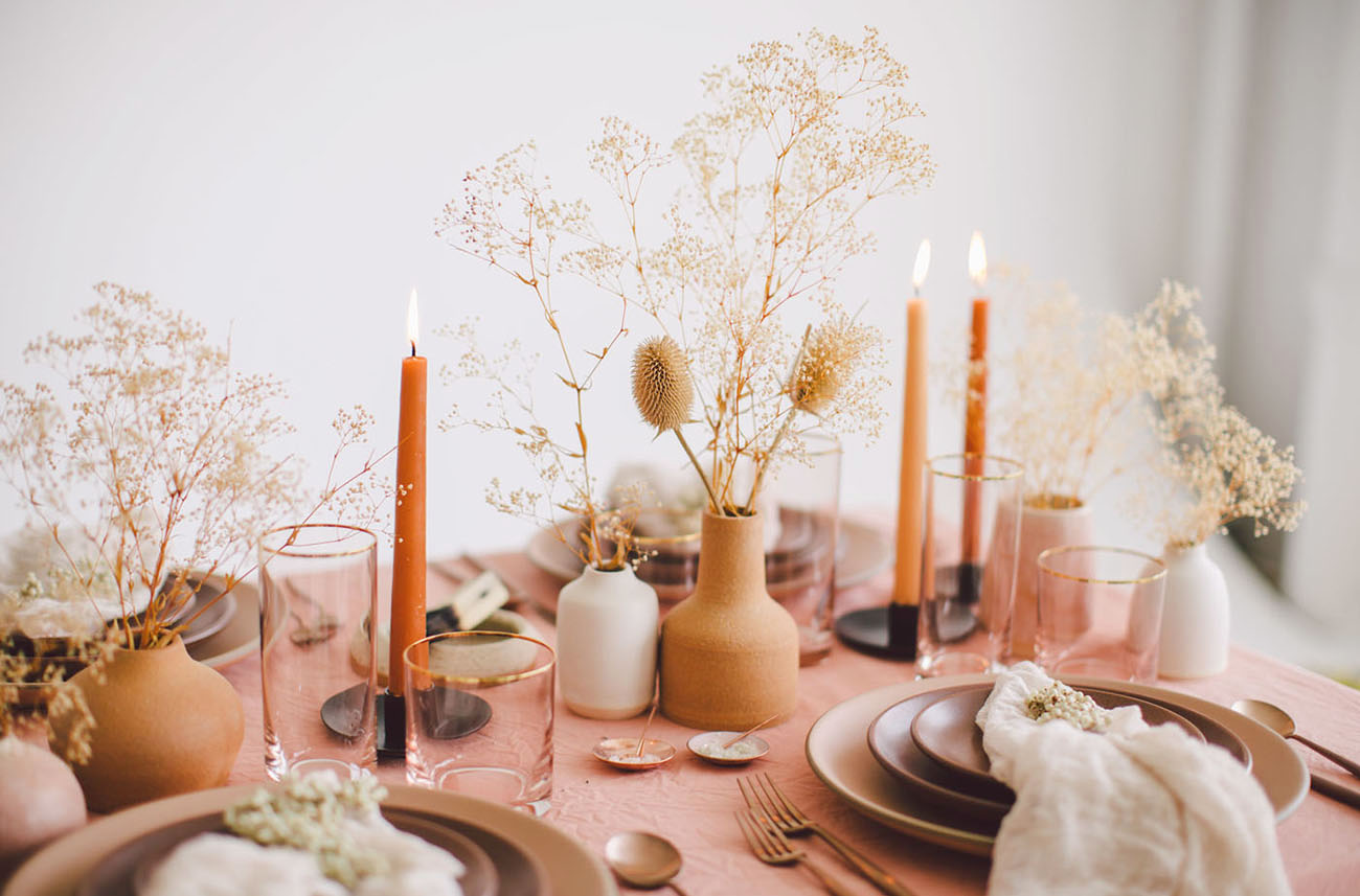terra cotta decor small vases and flowers with candles