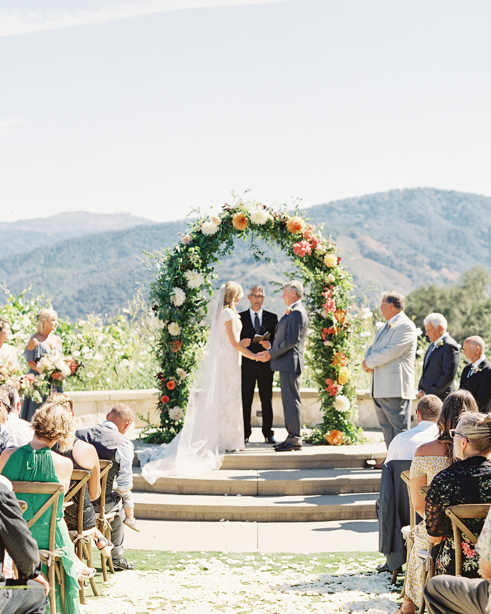 laurie michael wedding ceremony under floral arch