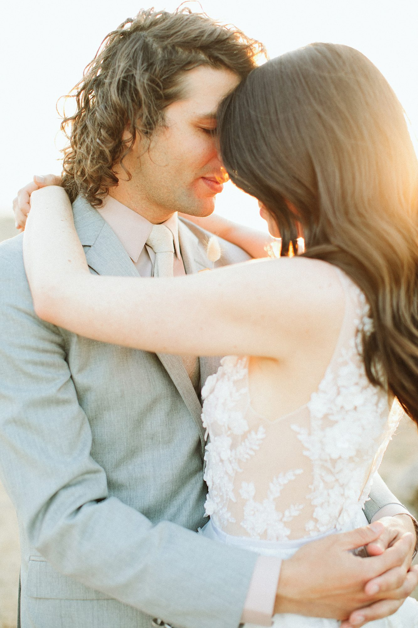 ashley basil wedding couple embrace golden hour