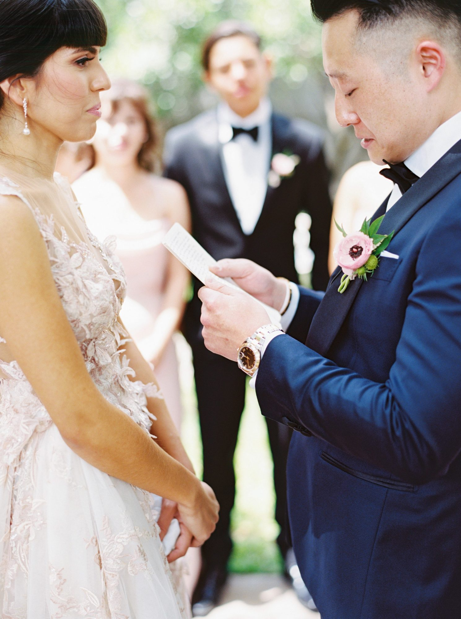 groom read vows to bride wedding party witness