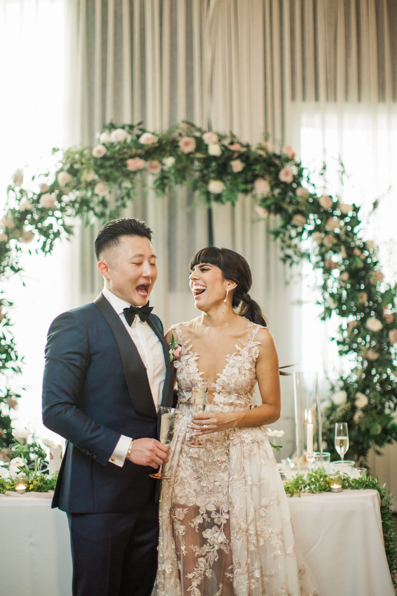 bride groom sweetheart table floral arch