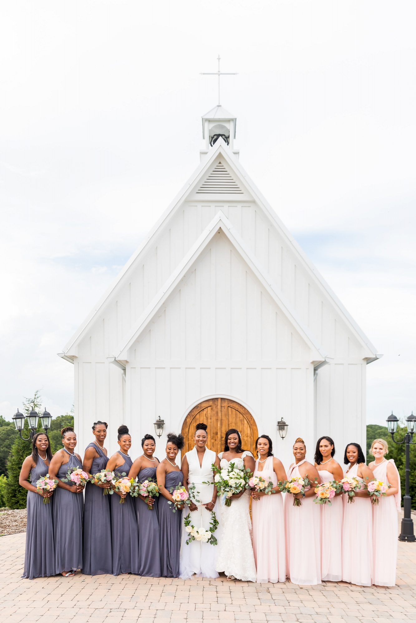cara chamique wedding bridesmaids in front of chapel