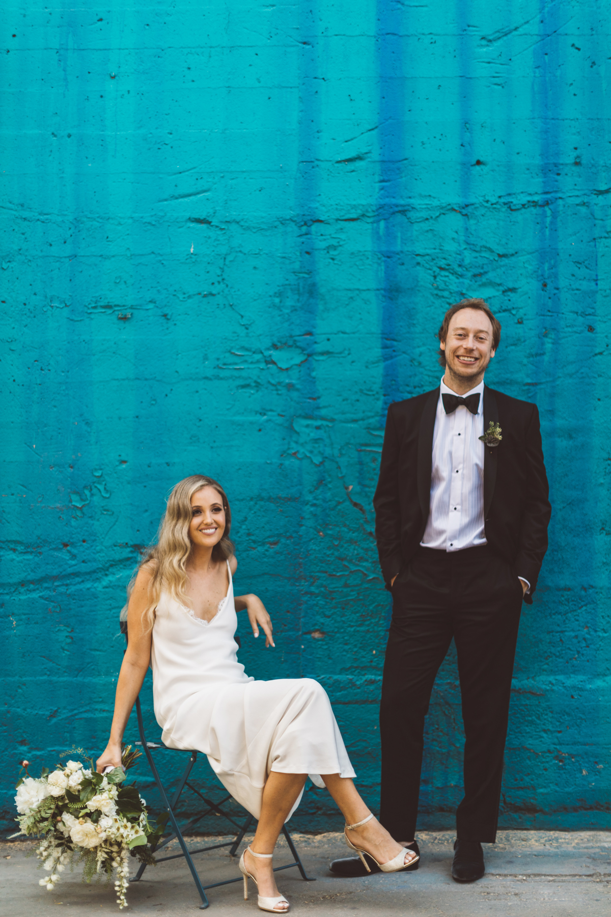 kaily matt wedding los angeles couple in front of blue wall