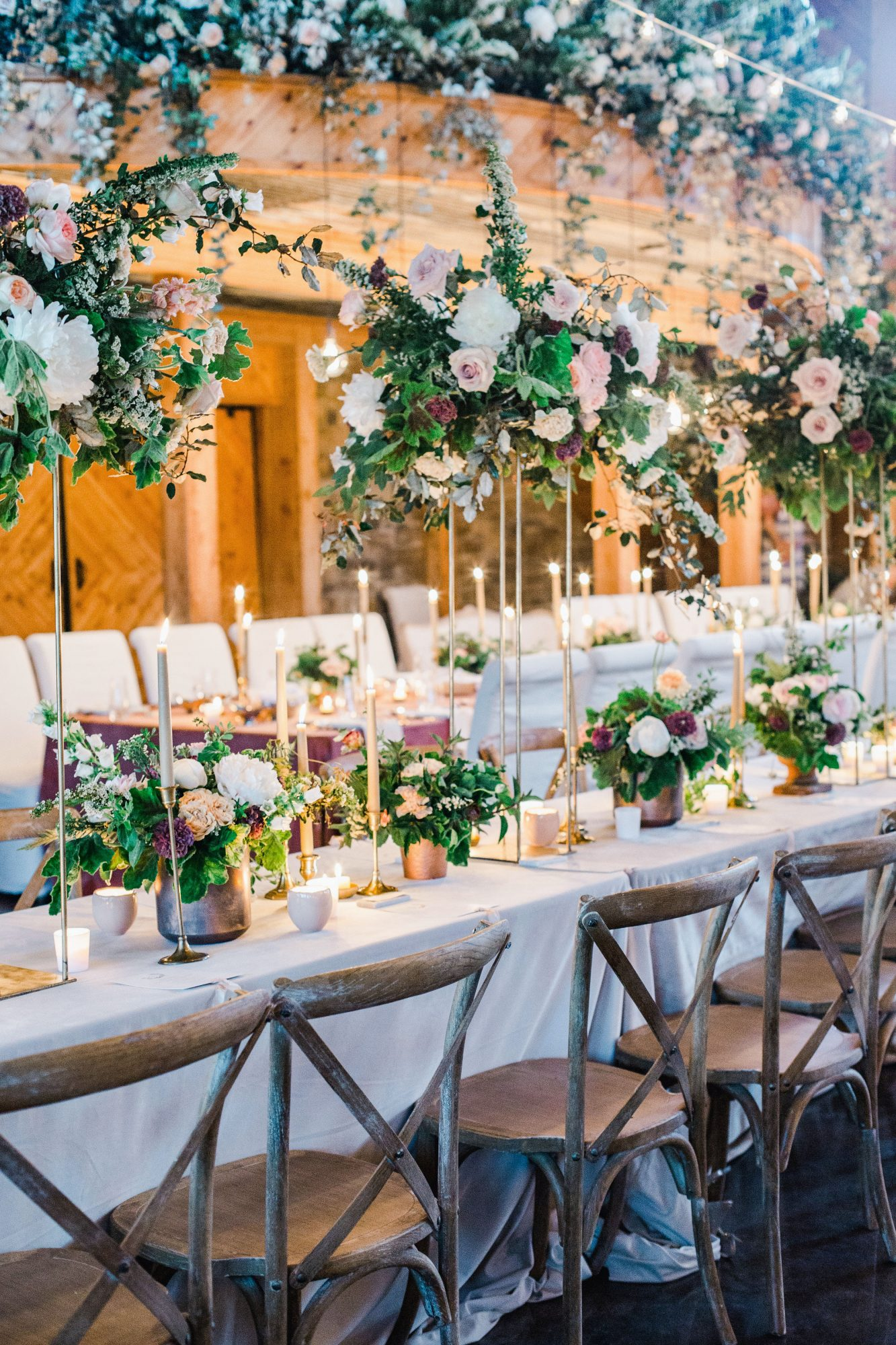 wedding reception tables suspended flowers and candles