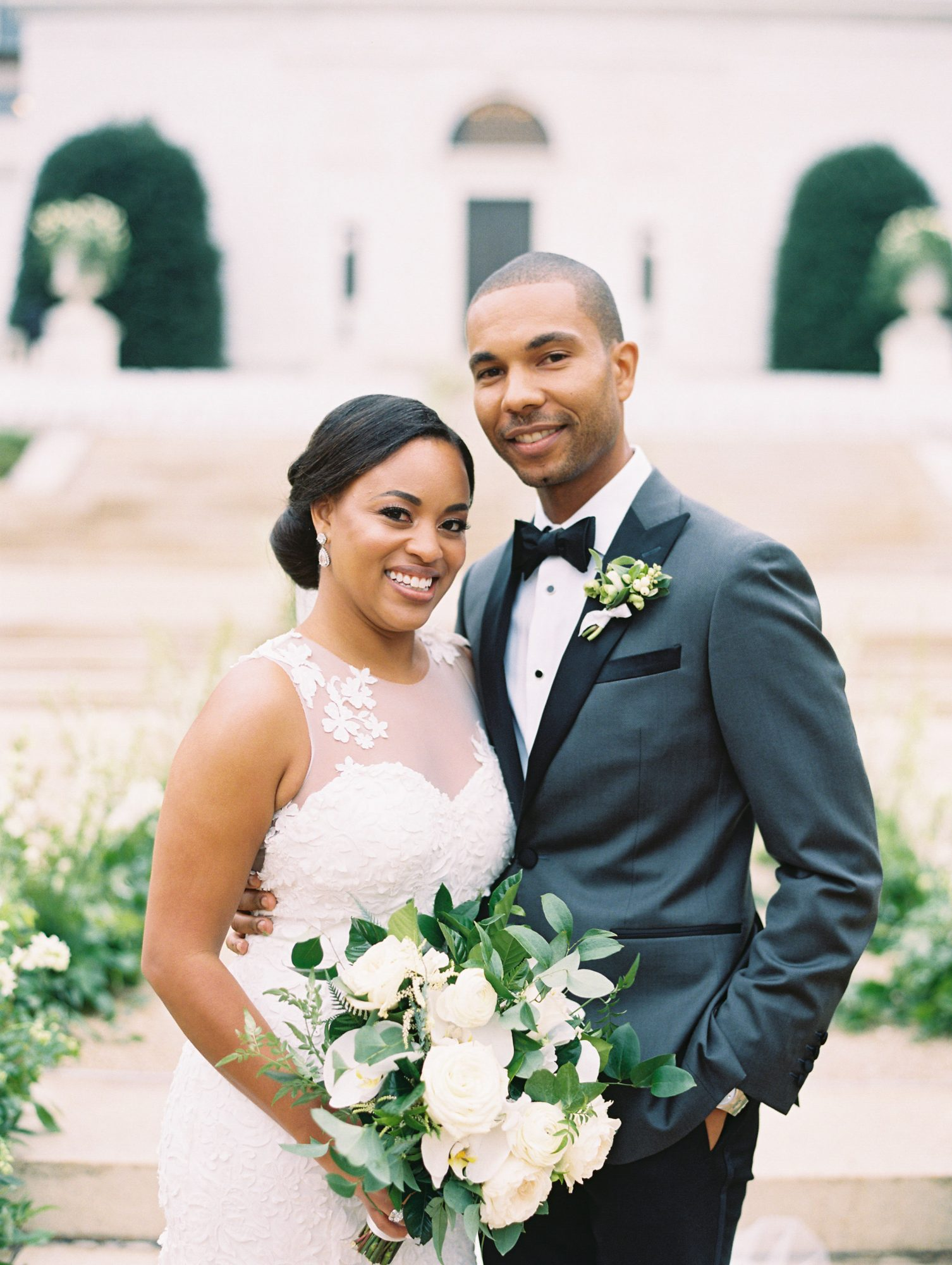 melissa justen wedding couple in front of venue with bouquet