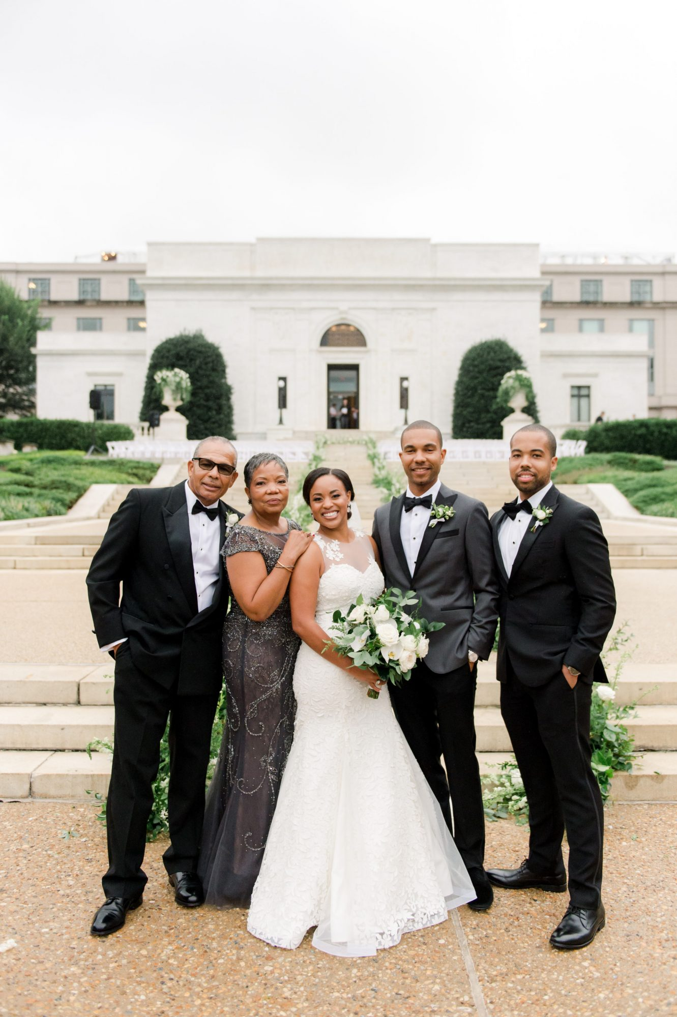 melissa justen wedding couple and family in front of venue