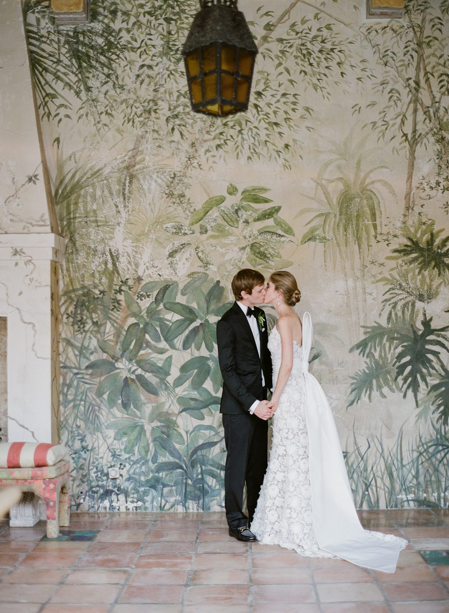 chelsea conor wedding couple kissing in front of mural